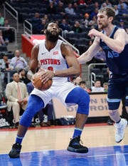Pistons' Andre Drummond drives around Grizzlies' Tyler Zeller in the first quarter.