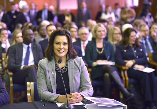 Michigan Gov. Gretchen Whitmer, seen presenting her budget proposal to lawmakers on March 5, has told residents she is willing to stake her political career on the road funding fight.