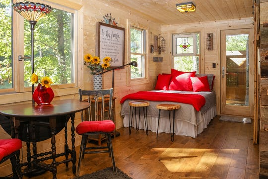 : This hideaway treehouse is in lakeside Greers Ferry in Arkansas. This 20-by-12-foot treehouse is clad in cedar and features insulated windows and French doors. The treehouse was built for adventuring adults to enjoy with electricity, a kitchenette, bathroom and outdoor shower.