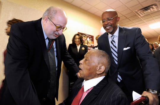 Jonathan Wolman talks with Judge Damon Keith as Butch Hollowell, right, managing partner of the Miller Law Firm, shares a laugh with others  on February 14, 2018, during the judge's 31st Annual Soul Food Luncheon at the U.S. federal courthouse in  Detroit.