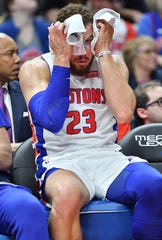 A dejected Blake Griffin was limited to 18 minutes of action because of a sore left knee as he sits on the bench in the third quarter.