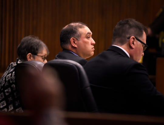 Defendant Mark Bessner, center, listens during the preliminary instructions to the jury by Judge Margaret Van Houten.