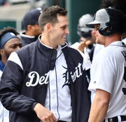 Tigers pitcher Matthew Boyd, left, smiles while talking with John Hicks after Hicks' solo home run in the sixth inning.