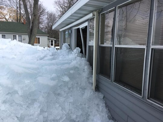 Ice pushing from Lake Houghton in Michigan is damaging homes.