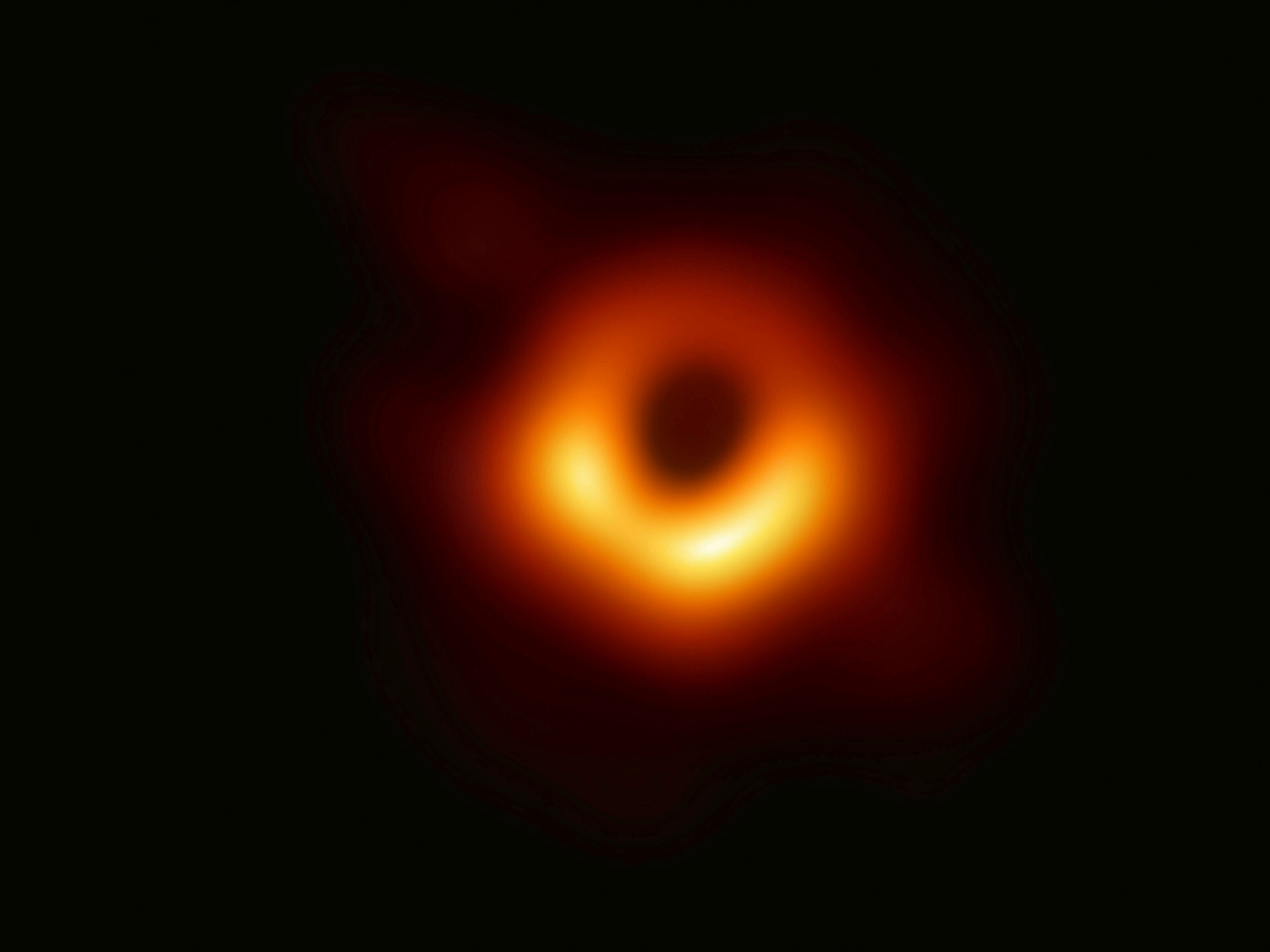This image, released Wednesday, April 10, 2019, by the Event Horizon Telescope, shows a black hole. Scientists revealed the first image ever made of the cosmic phenomenon after assembling data gathered by a network of radio telescopes around the world.
