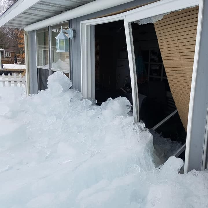 Ice from Michigan's Houghton Lake damages homes