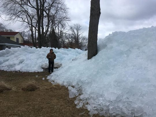 Ice piled up on the shore of Houghton Lake in Michigan.