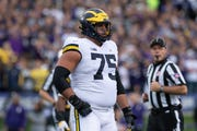 """""""We are able to look at the sideline, and listen to Shea, and we know what we're doing immediately,"""" says Michigan offensive lineman Jon Runyan."""