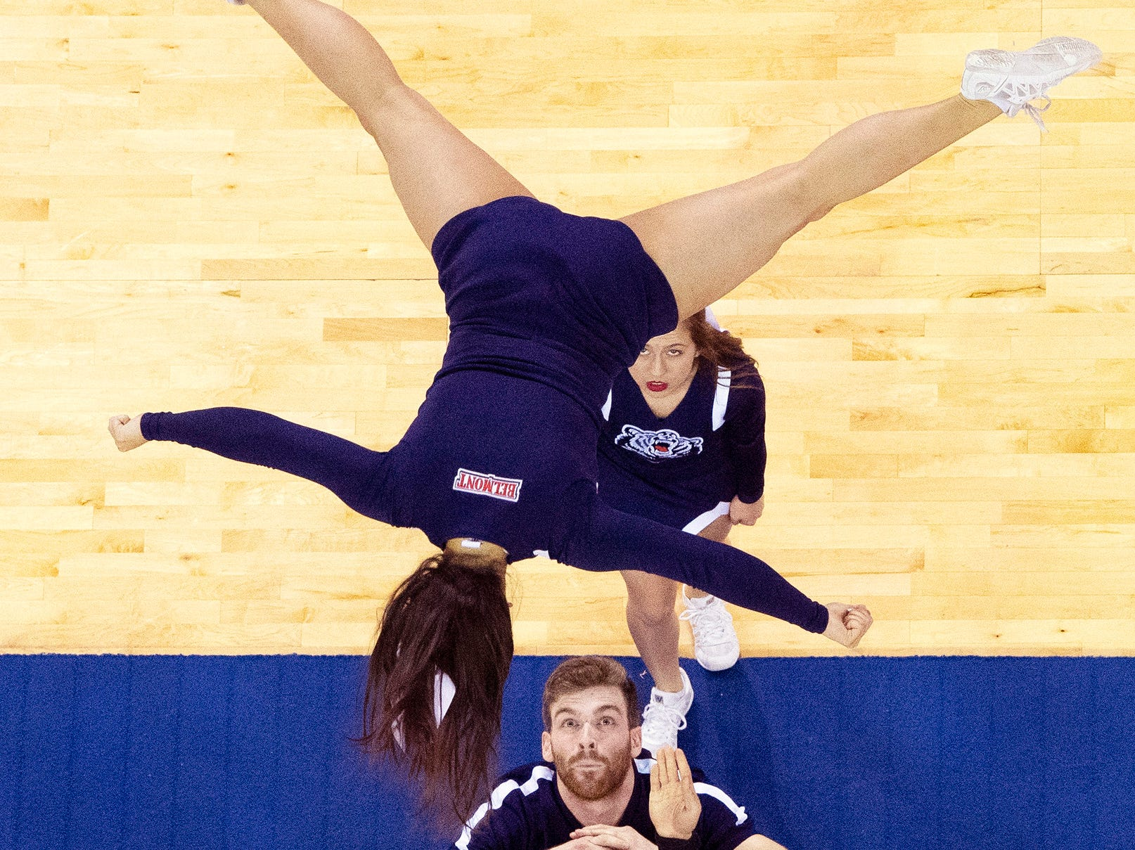 The Belmont Cheerleaders look to catch their flyer during a halftime performance at the Ford Center in Evansville Friday afternoon, March 8, 2019. The Belmont Bruins women's basketball team beat the Tennessee Tech Golden Eagles in the semifinal game of the Ohio Valley Conference Basketball Championships.