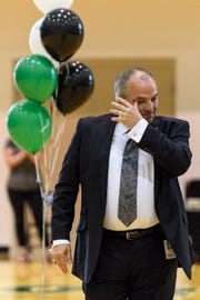 John D. Skinner, principal of North High School, wipes a tear away from his eyes as he accepts the 2019 Building Principal of the Year award during an assembly at the school in Evansville, Ind., Wednesday, April 10, 2019. He spent several weeks preparing the assembly to celebrate the three high school teacher finalists, who all work at North, and didn't know he would also be recognized.