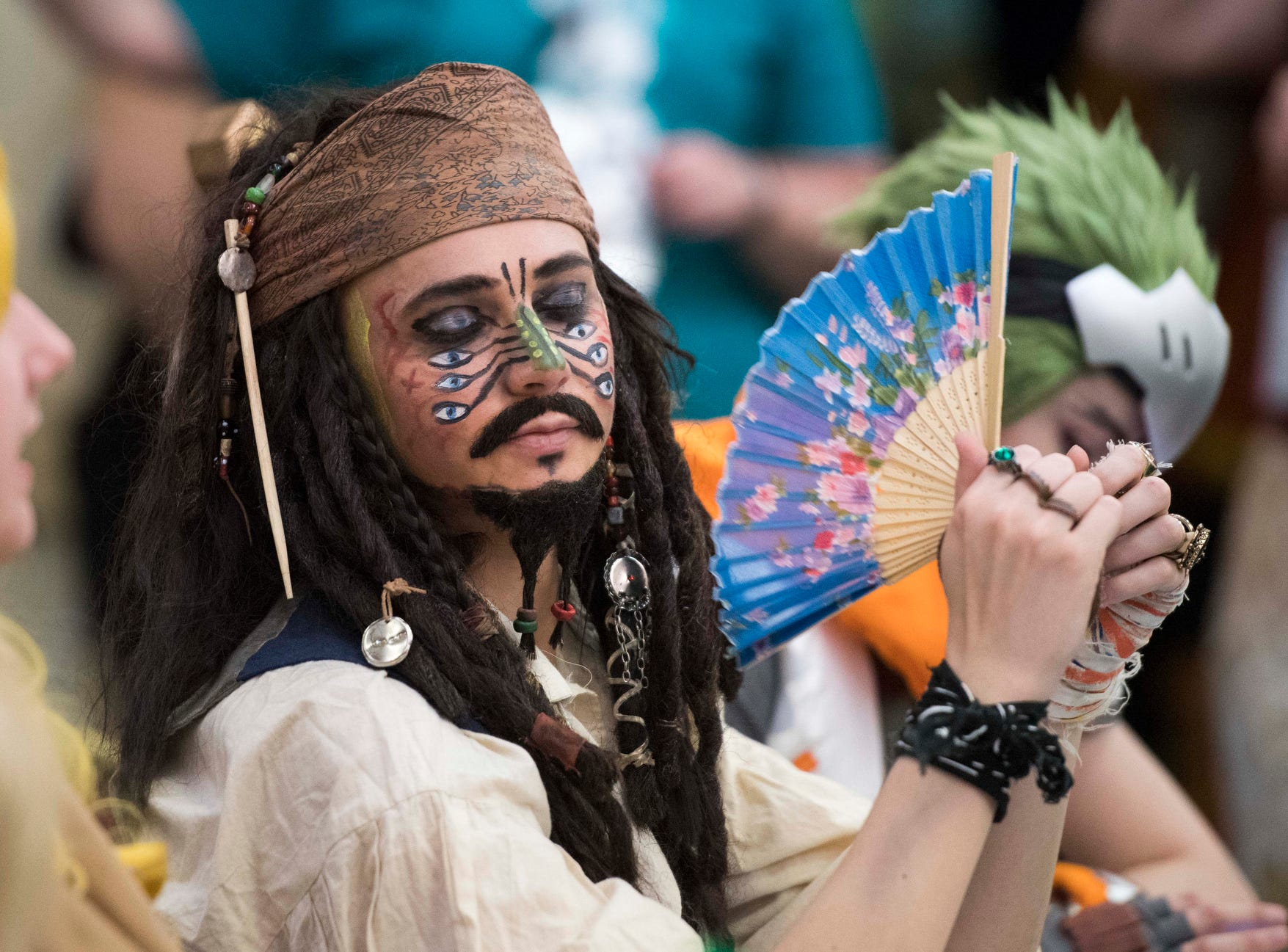 Judge Bret Collins dressed as Cannibal Jack Sparrow fans himself while waiting for the Cosplay Contest to start during EvilleCon, Saturday, afternoon, March 23, 2019.