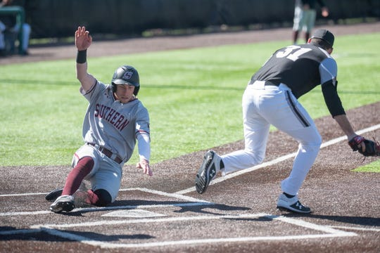Will LaRue slides into home during a Southern Illinois University baseball game.