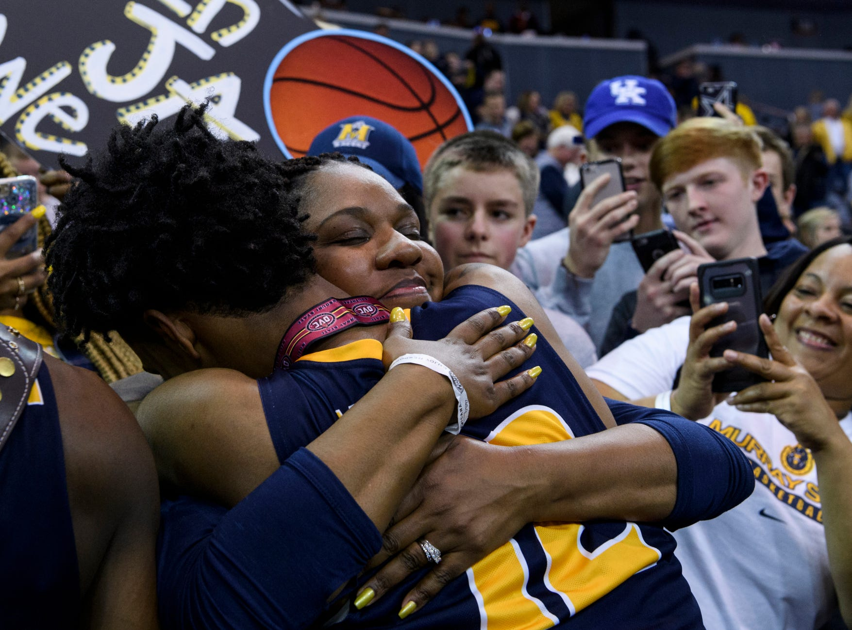 Murray State's Ja Morant (12) and his mother Jamie Morant embrace around a big crowd celebrating the team's Ohio Valley Conference championship win at Ford Center in Evansville, Ind., Saturday, March 9, 2019. The Racers earned the OVC men's championship title after defeating the Belmont Bruins, 77-65.