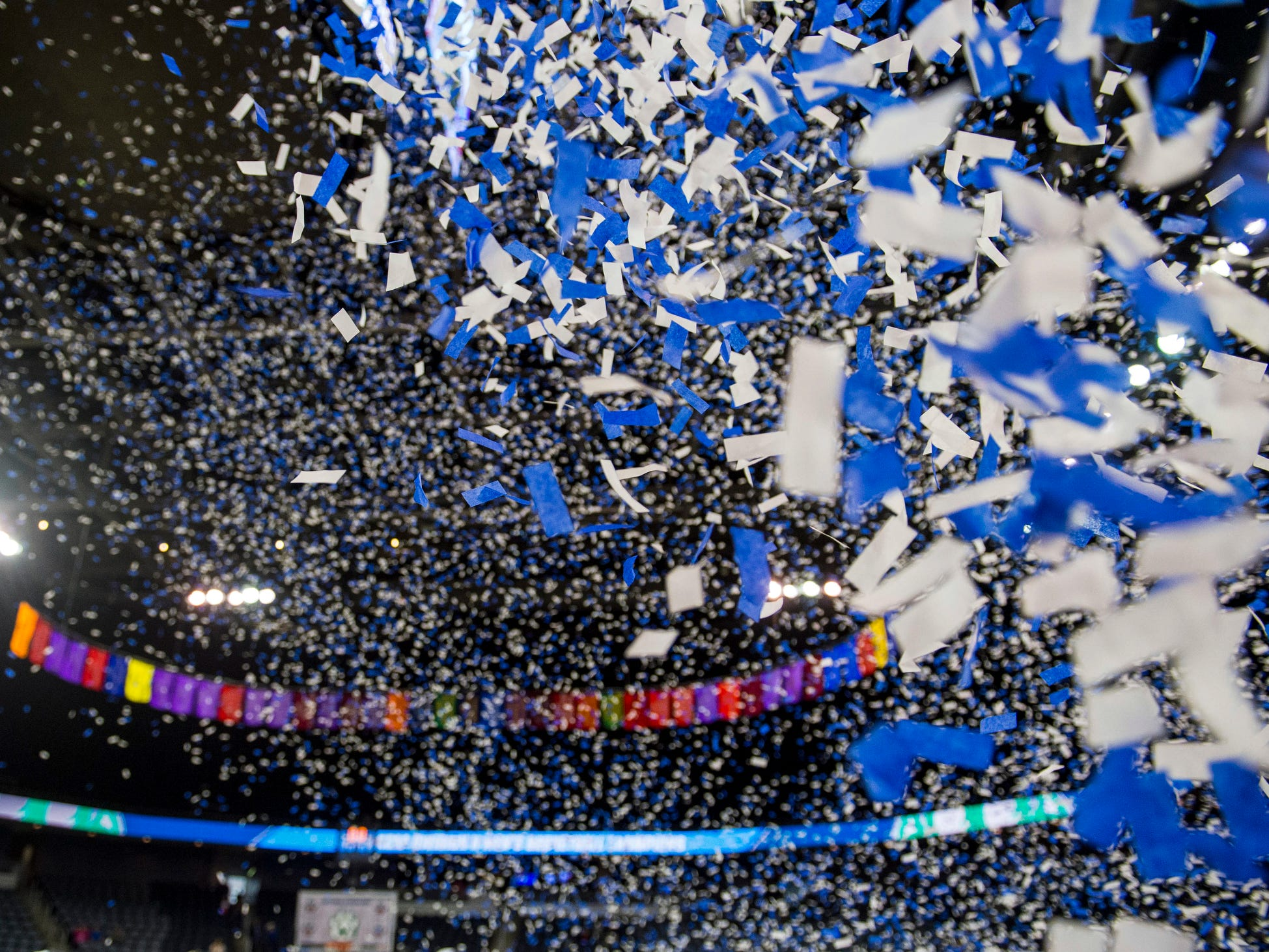 Confetti is shot from a canon as the Northwest Missouri State Bearcats celebrate their victory over the Point Loma Sea Lions in the NCAA Division II Men's Basketball National Championship game at Ford Center in Evansville, Ind., Saturday, March 30, 2019.  The Northwest Missouri State Bearcats defeated the Point Loma Sea Lions, 64-58.