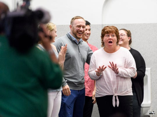 Special Education teacher Jennifer L. Stoll, right, reacts to the large assembly held in her honor at Washington Middle School in Evansville, Ind., Wednesday, April 10, 2019. She was named the 2019 Middle School Teacher of the Year.
