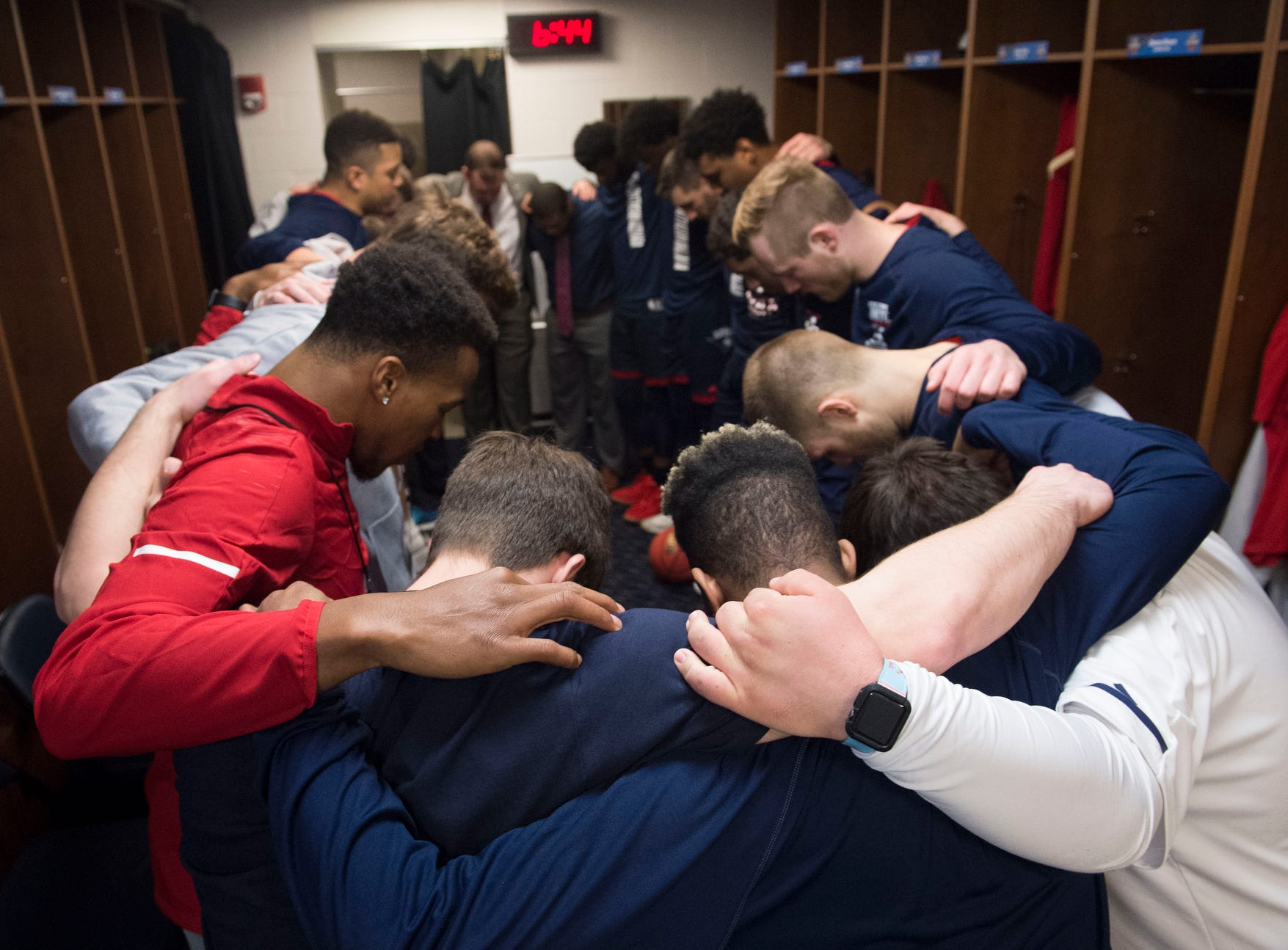 University of Southern Indiana Screaming Eagles gather in the locker room as they say the Lord's prayer before taking the court for the NCAA Men's Division II Quarterfinals at Ford Center in Evansville, Ind., Wednesday, March 27, 2019. USI defeated West Texas A&M, 94-84.