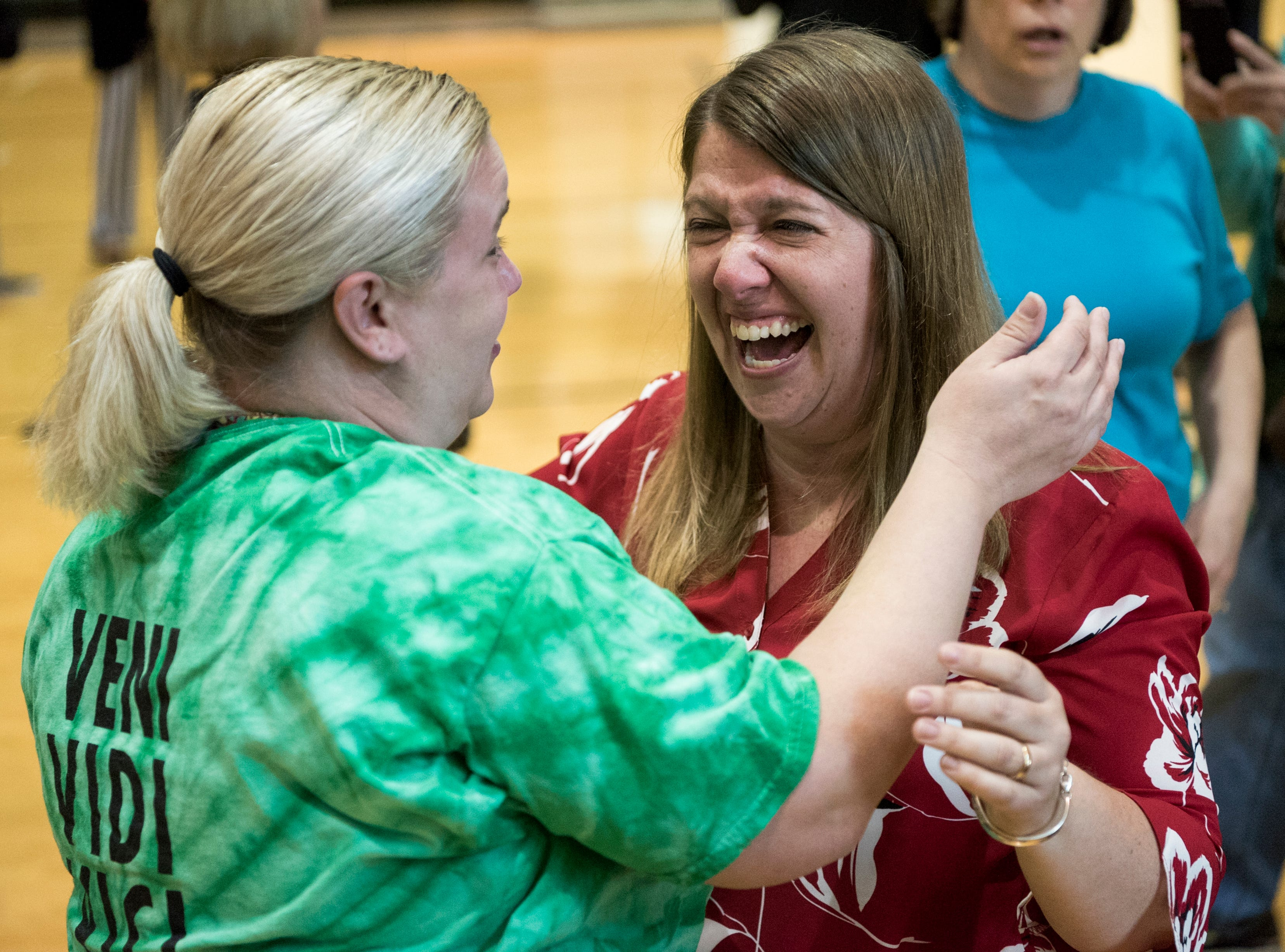 """Liz Hanisch, left, embraces her best friend Andrea Gordon following the Outstanding Educators of the Year awards ceremony at North High School in Evansville, Ind., Wednesday, April 10, 2019. """"This is the longest I've ever had to keep a secret from her,"""" Hanisch said about Gordon being named the 2019 High School Teacher of the Year."""