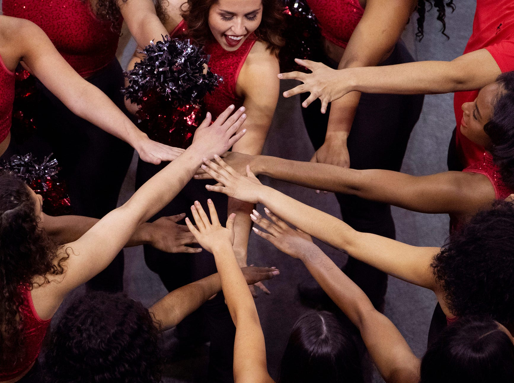 The Austin Peay Dance Team puts their hands in before taking the floor for their halftime routine during the quarterfinal game of the Ohio Valley Conference Women's Basketball Championship at the Ford Center Thursday afternoon, March 7, 2019. Tennessee Tech came out on top and advanced to Friday's semifinal game.