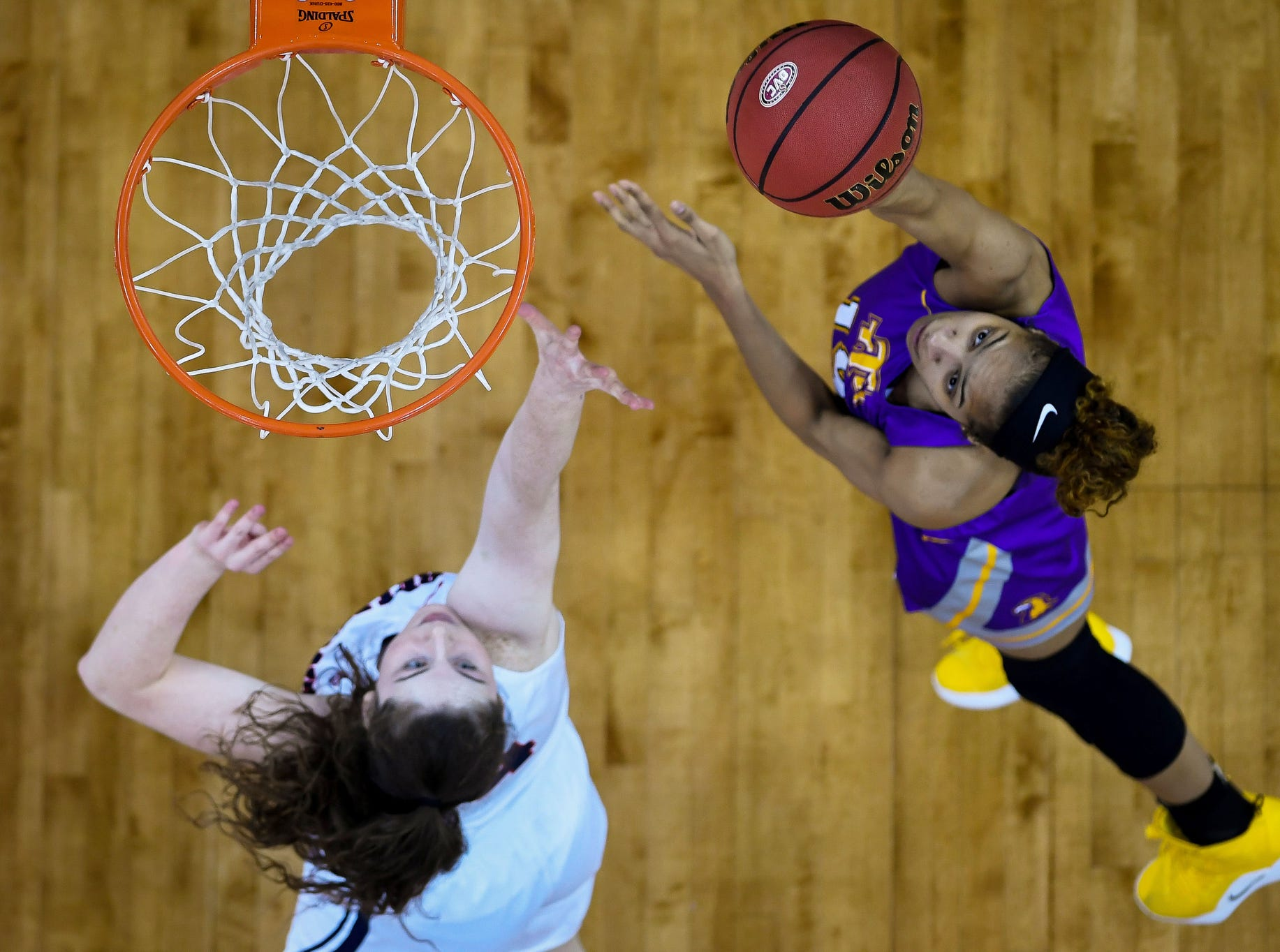 Tennessee Tech's Anacia Wilkinson (15) shoots over Belmont Bruins' Jamilyn Kinney (14) as the Belmont Bruins play the Tennessee Tech Golden Eagles in the Ohio Valley Conference semi-finals at the Evansville Ford Center Friday, March 8, 2019.