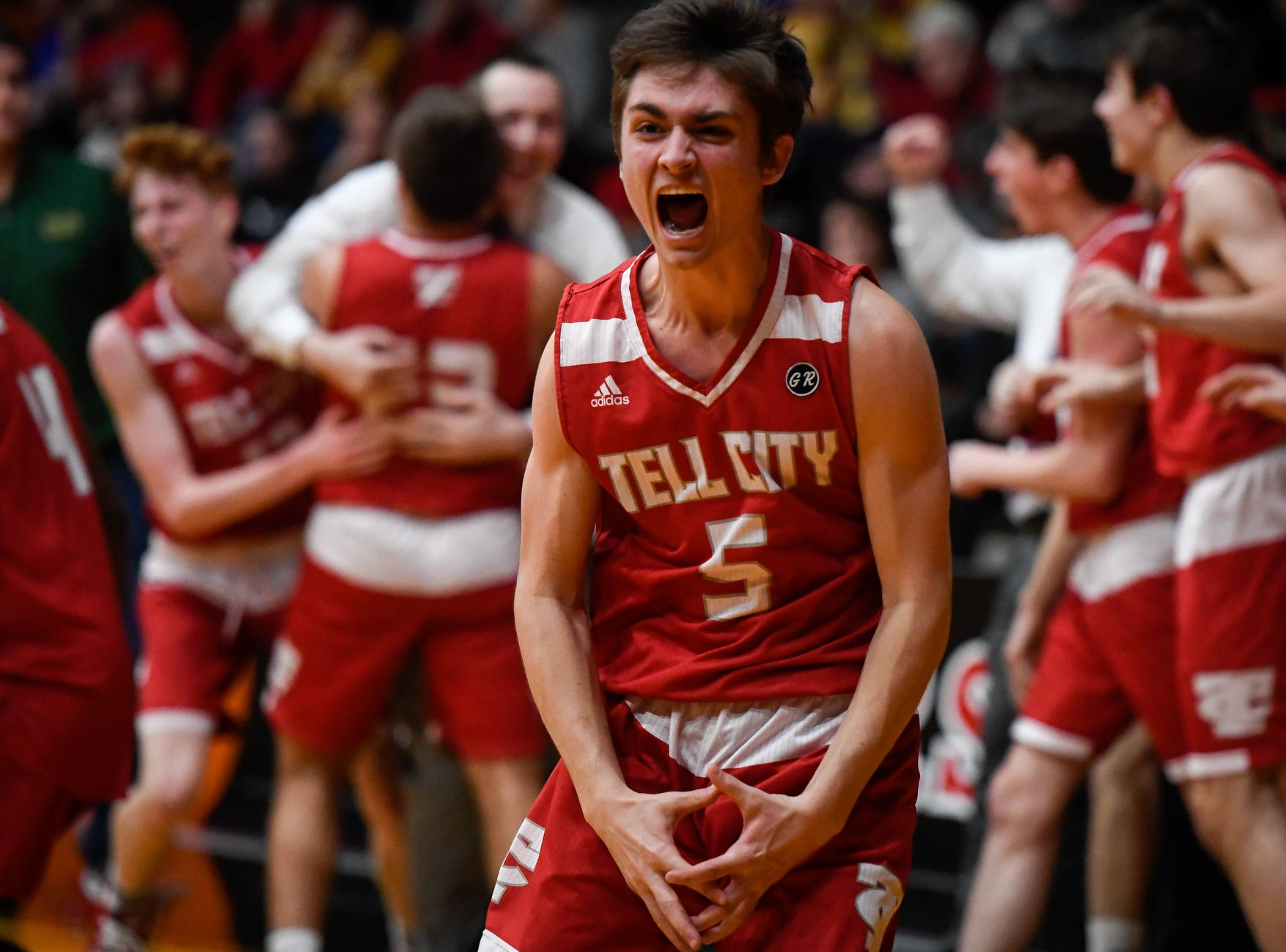Tell City's Kaden Chestnut (5) reacts to his team's win as the game-clock runs out during the Class 2A Sectional Championship against the Mater Dei Wildcats at Huntingburg's Memorial Gym, Saturday, March 2, 2019.