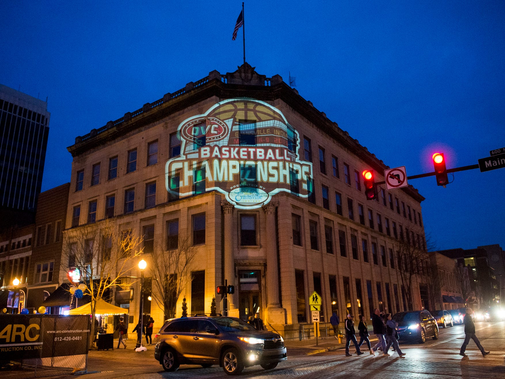 The Ohio Valley Conference Tournament logo is projected on a building across from the Ford Center in Evansville, Ind., Friday, March 8, 2019.