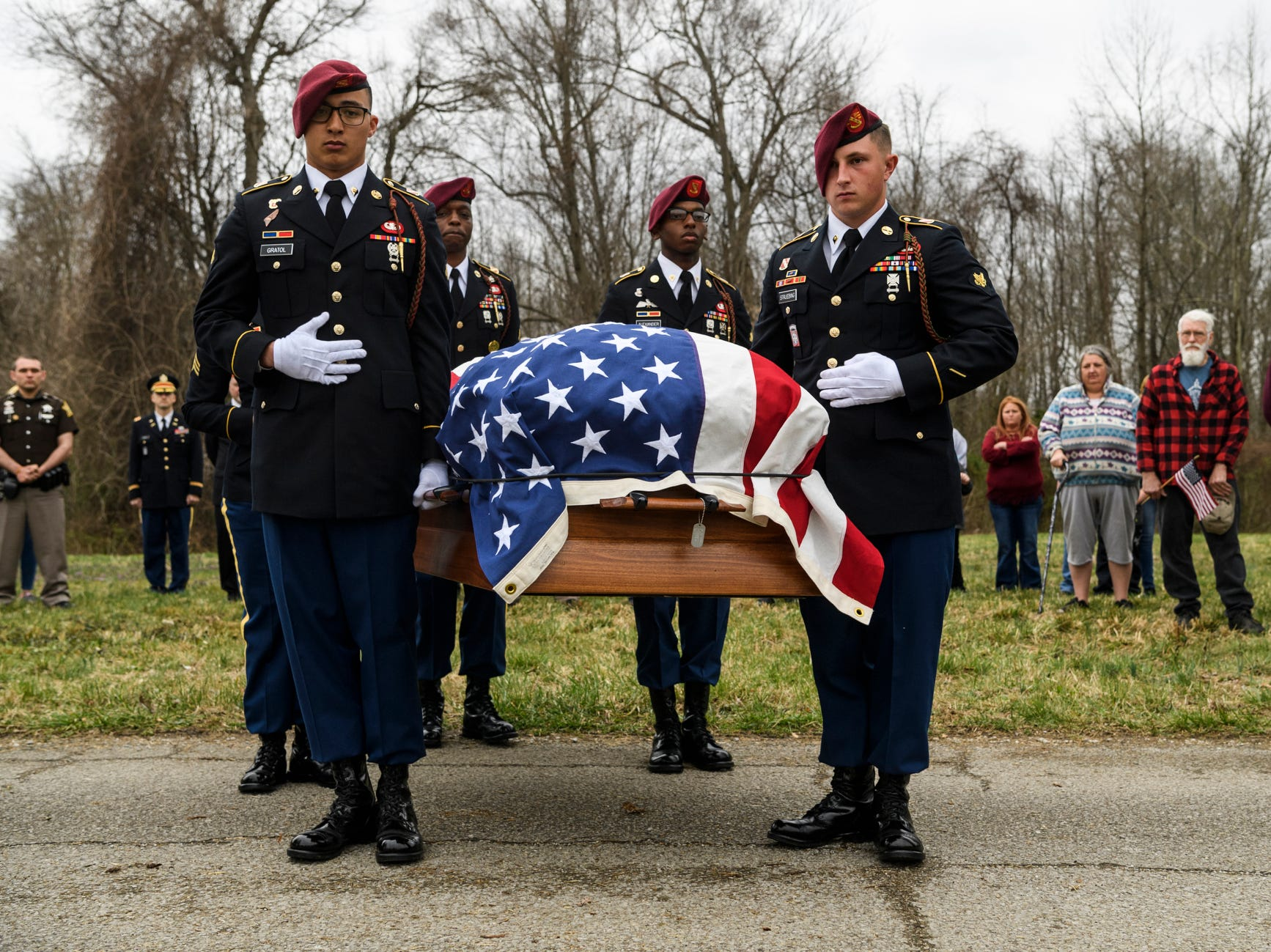 Members of the 319th 82nd Airborne Division Artillery of Fort Bragg, N.C., carefully escort the coffin of Pvt. 1st Class Clifford M. Mills to his burial plot at Calvary Cemetery in Troy, Ind., Saturday, March 30, 2019. Pvt. Mills was declared missing in action 75 years ago, while fighting in Germany during World War II.