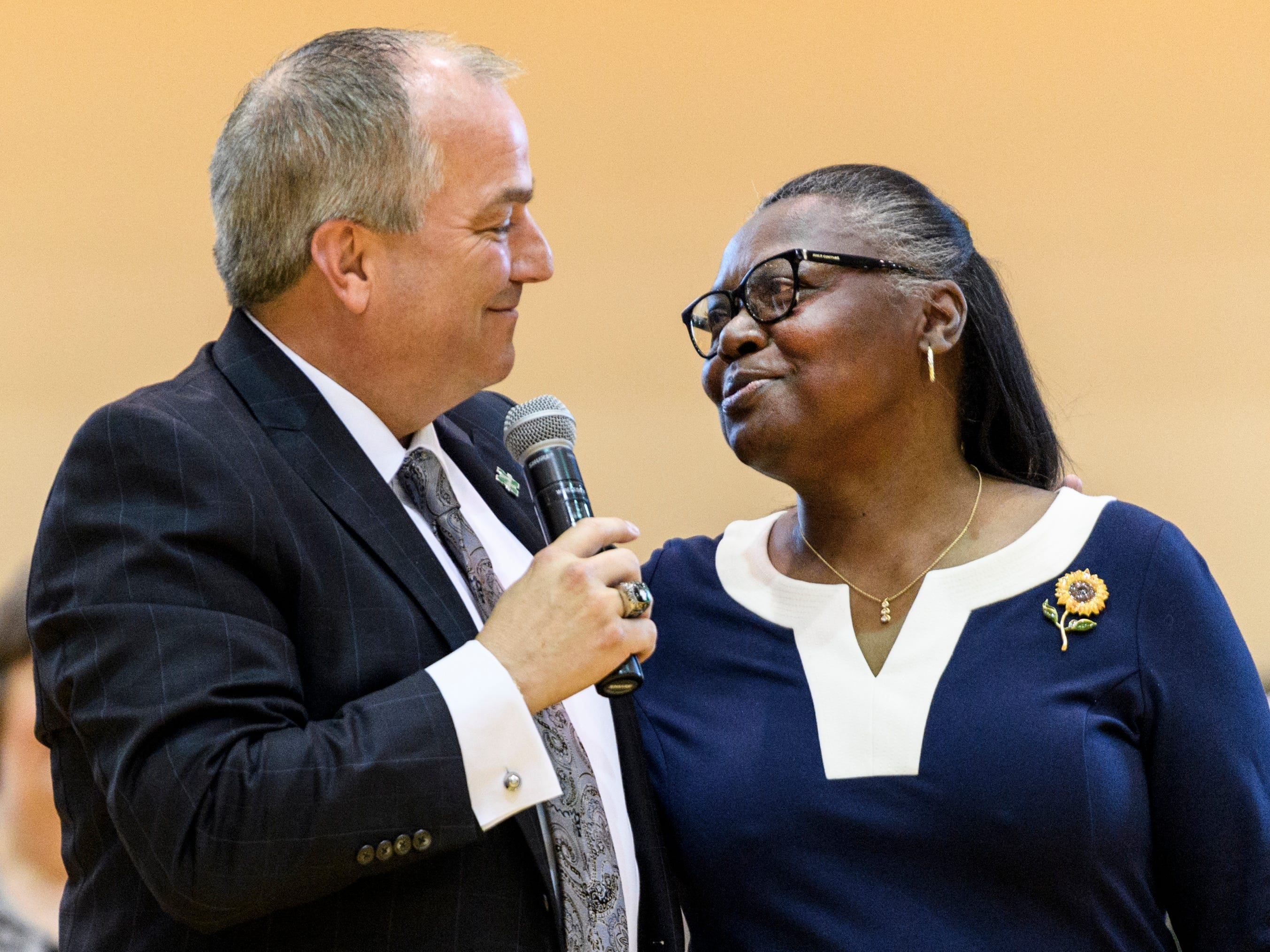 John D. Skinner, left, takes a moment to thank Shelia Huff, right, who helped him at the beginning of his education career during a school assembly at North High School in Evansville, Ind., Wednesday, April 10, 2019. Skinner was surprised with the 2019 Building Principal of the Year award after helping announce the high school teacher of the year award.