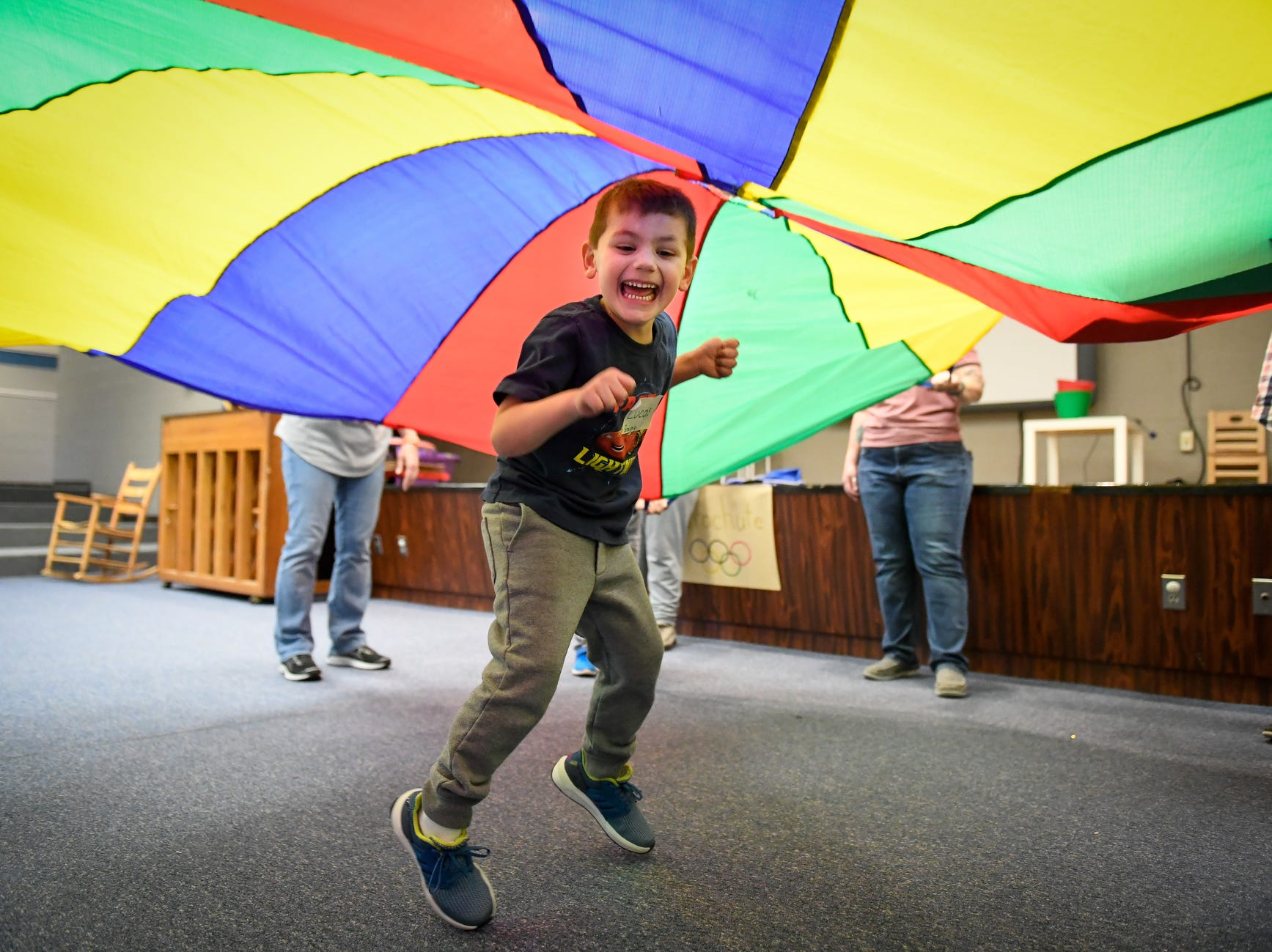 Taking his turn, Lucas Spanner, 9 years-old, plays under a parachute during the Special Olympics Unified Champion School Young Athlete program at Culver Early Learning Center ,Friday, March 22, 2019.