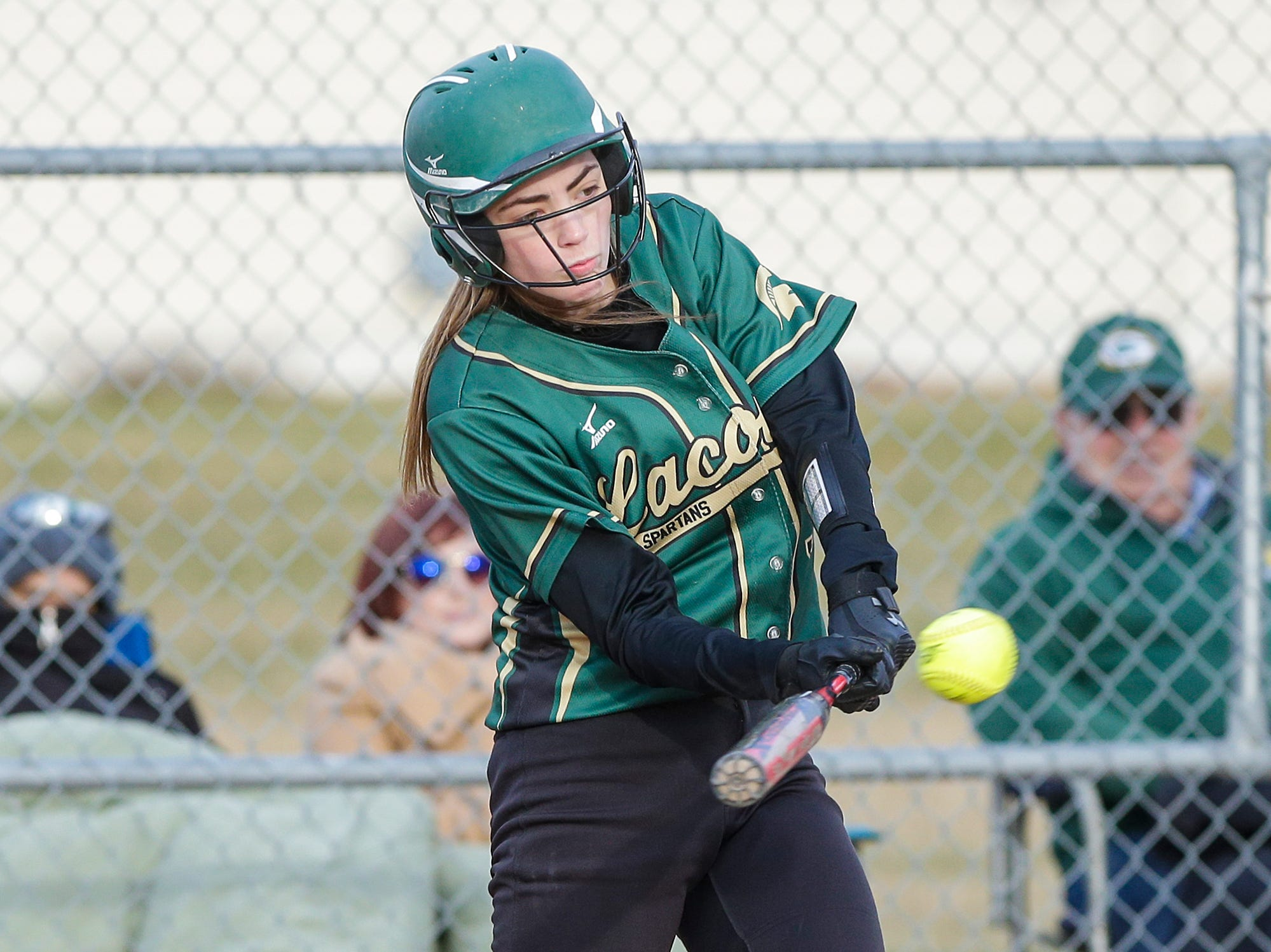 Laconia High School softball's Maci Grade hits a one run single in the fourth inning against Winnebago Lutheran Academy April 9, 2019 during their game in Fond du Lac, Wis. Laconia won the game 25-9. Doug Raflik/USA TODAY NETWORK-Wisconsin