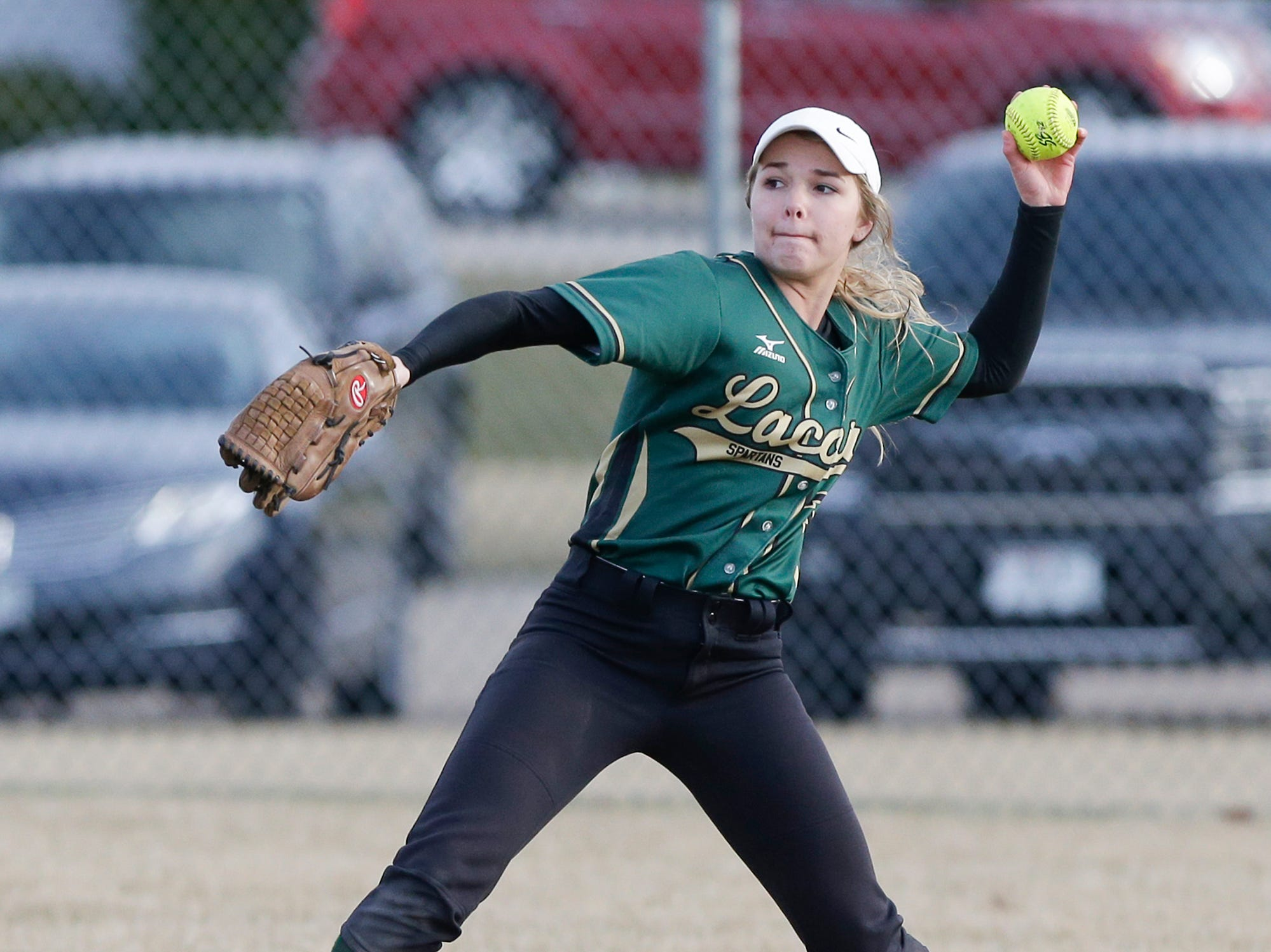 Laconia High School softball's Hailey Bartz fields a ball against Winnebago Lutheran Academy April 9, 2019 during their game in Fond du Lac, Wis. Laconia won the game 25-9. Doug Raflik/USA TODAY NETWORK-Wisconsin