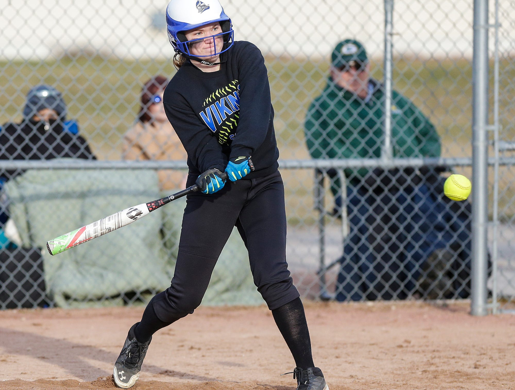 Winnebago Lutheran Academy softball's Kylie Schwefel hits a lead off single in the fourth inning against Laconia High School April 9, 2019 during their game in Fond du Lac, Wis. Laconia won the game 25-9. Doug Raflik/USA TODAY NETWORK-Wisconsin