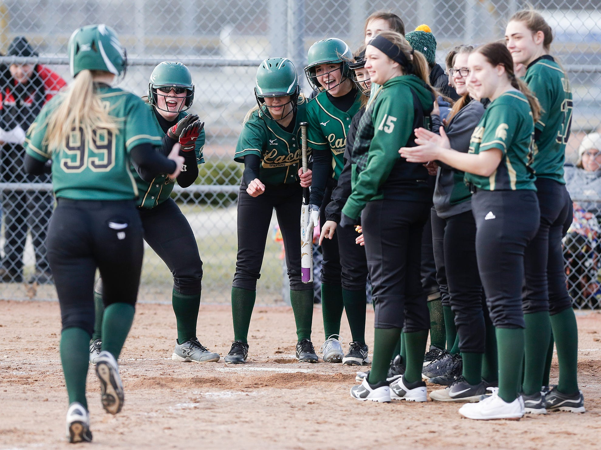 The Laconia High School softball team waits to congratulate Faith Weed after her homerun against Winnebago Lutheran Academy April 9, 2019 during their game in Fond du Lac, Wis. Laconia won the game 25-9. Doug Raflik/USA TODAY NETWORK-Wisconsin