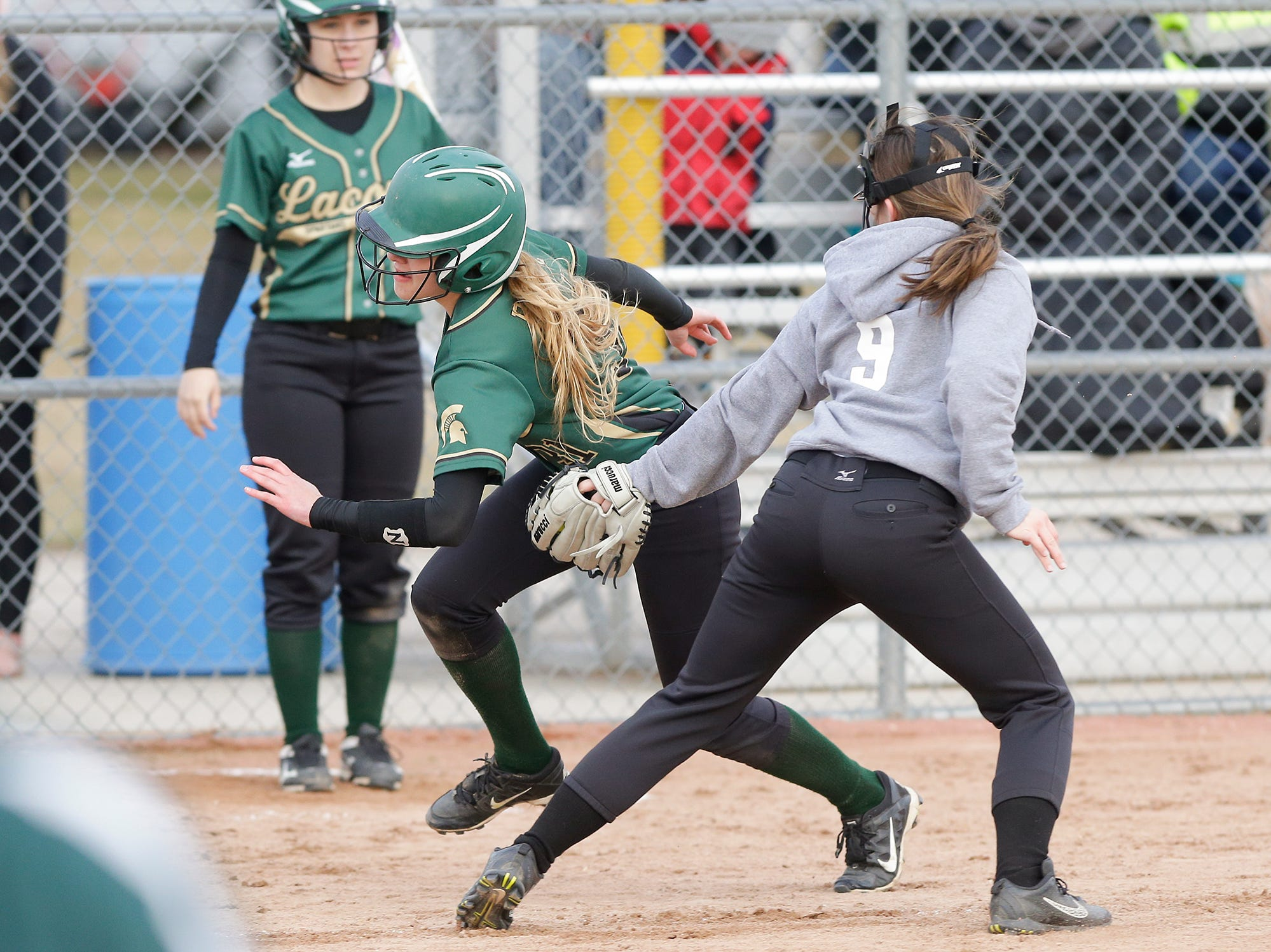 Laconia High School softball's Hailey Bartz avoids a tag at home from Winnebago Lutheran Academy's Shania Shea April 9, 2019 during their game in Fond du Lac, Wis. Laconia won the game 25-9. Doug Raflik/USA TODAY NETWORK-Wisconsin