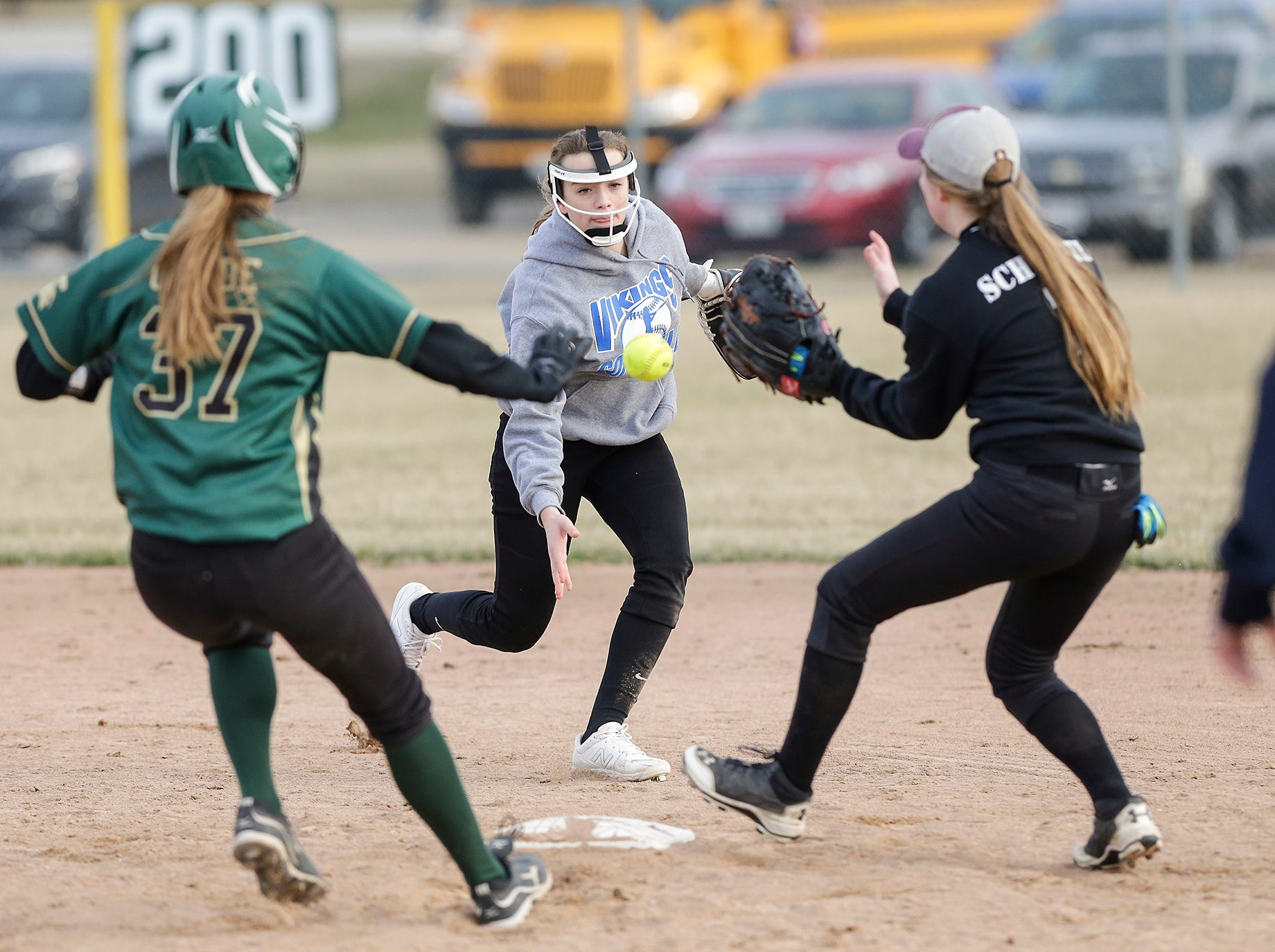 Winnebago Lutheran Academy softball's Rylee Loehr (center) throws the ball to Kylie Schwefel to tag out Laconia High School's Maci Grade at second base April 9, 2019 during their game in Fond du Lac, Wis. Laconia won the game 25-9. Doug Raflik/USA TODAY NETWORK-Wisconsin