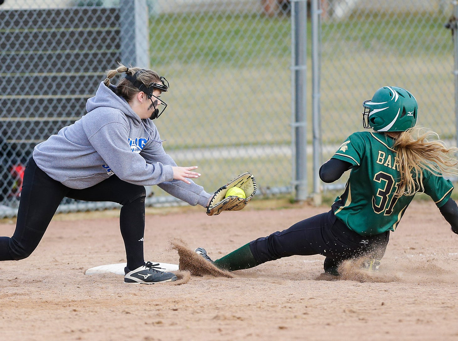 Laconia High School softball's Hailey Bartz slides into third base safe against Winnebago Lutheran Academy April 9, 2019 during their game in Fond du Lac, Wis. Laconia won the game 25-9. Doug Raflik/USA TODAY NETWORK-Wisconsin