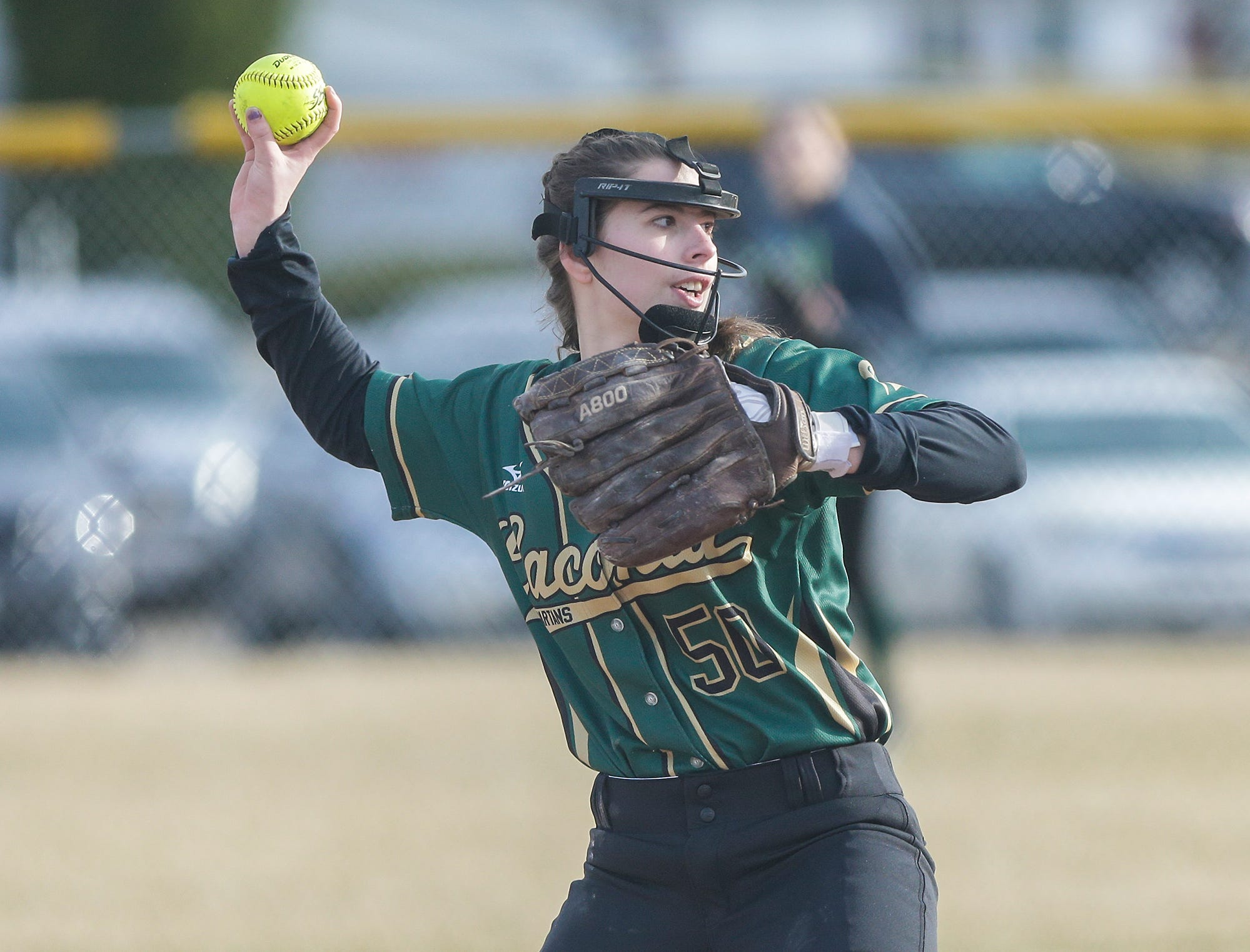 Laconia High School softball's Sam Hamburgur throws a ball to first against Winnebago Lutheran Academy April 9, 2019 during their game in Fond du Lac, Wis. Laconia won the game 25-9. Doug Raflik/USA TODAY NETWORK-Wisconsin