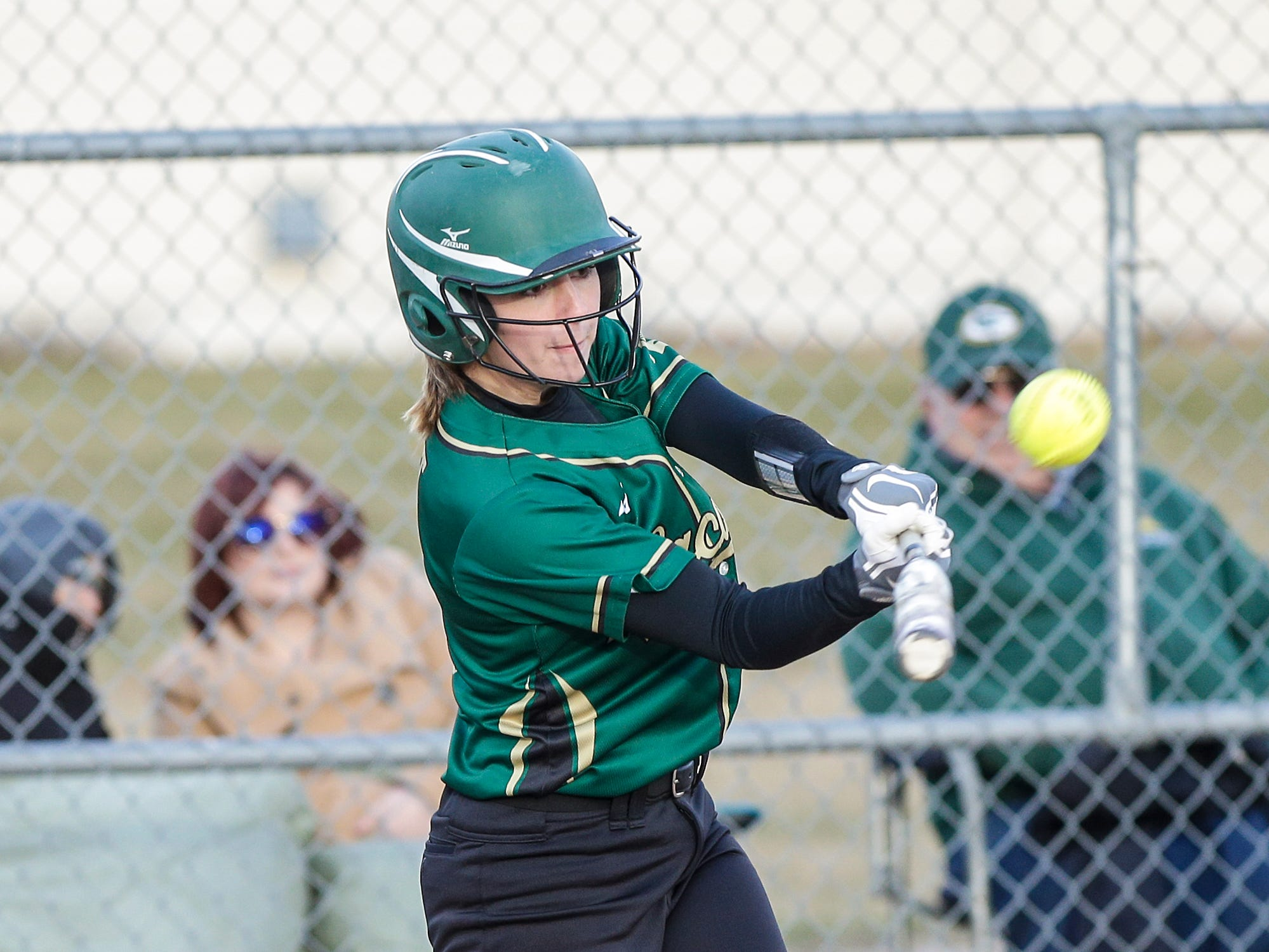 Laconia High School softball's Brooklyn Smit hits a sacrafice fly ball against Winnebago Lutheran Academy that scored a run in the 5th inning April 9, 2019 during their game in Fond du Lac, Wis. Laconia won the game 25-9. Doug Raflik/USA TODAY NETWORK-Wisconsin