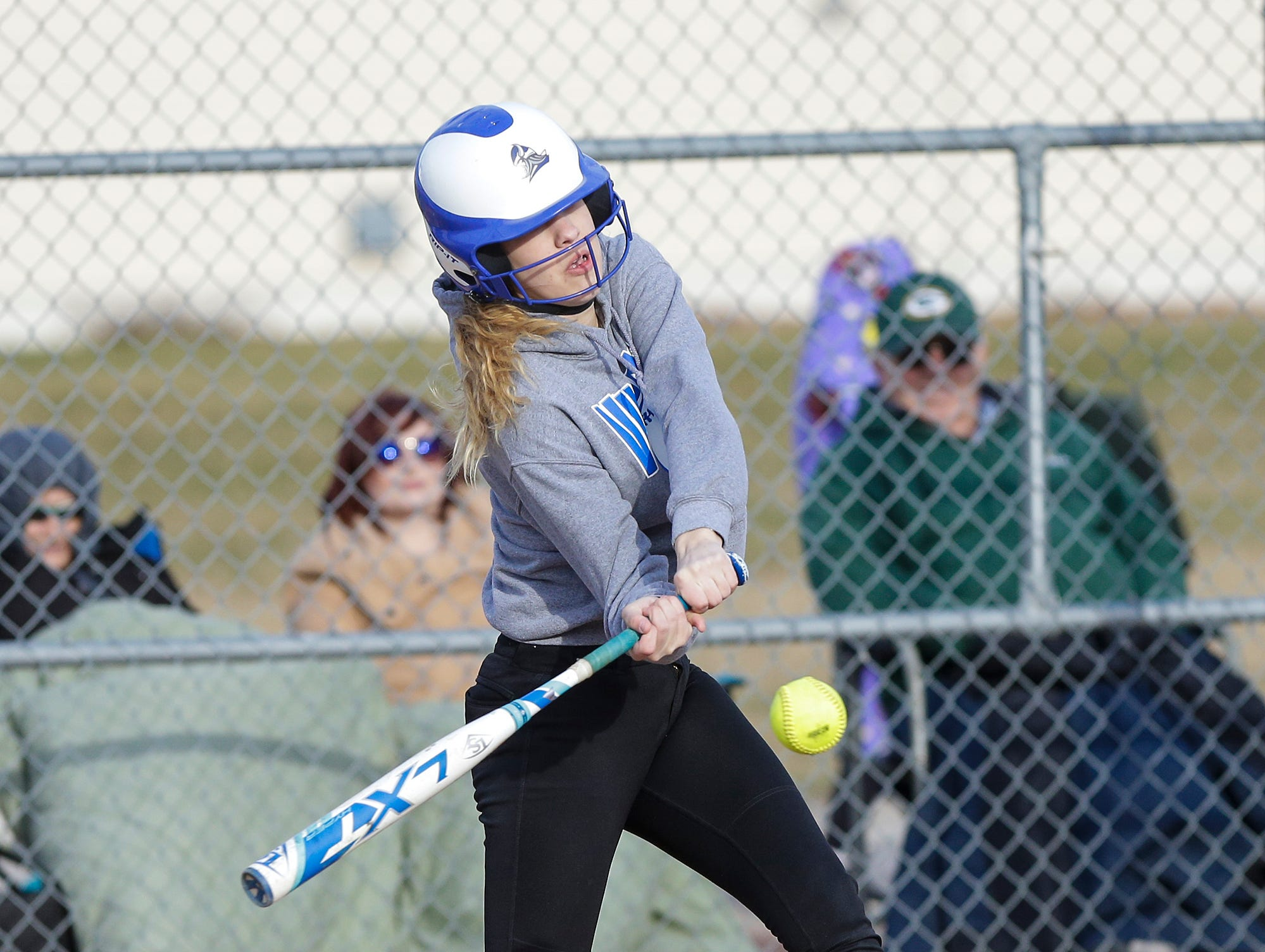 Winnebago Lutheran Academy softball's Kaylee Frey hits a three run homerun against Laconia High School April 9, 2019 in the third inning during their game in Fond du Lac, Wis. Laconia won the game 25-9. Doug Raflik/USA TODAY NETWORK-Wisconsin