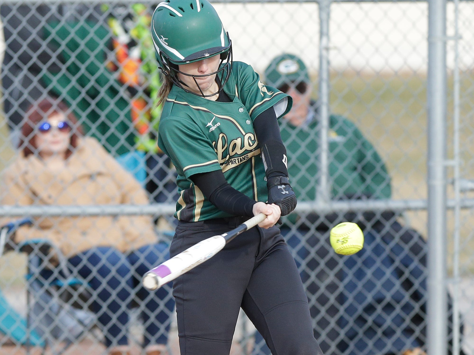 Laconia High School softball's Kaysie Smith swings at a pitch against Winnebago Lutheran Academy April 9, 2019 during their game in Fond du Lac, Wis. Laconia won the game 25-9. Doug Raflik/USA TODAY NETWORK-Wisconsin