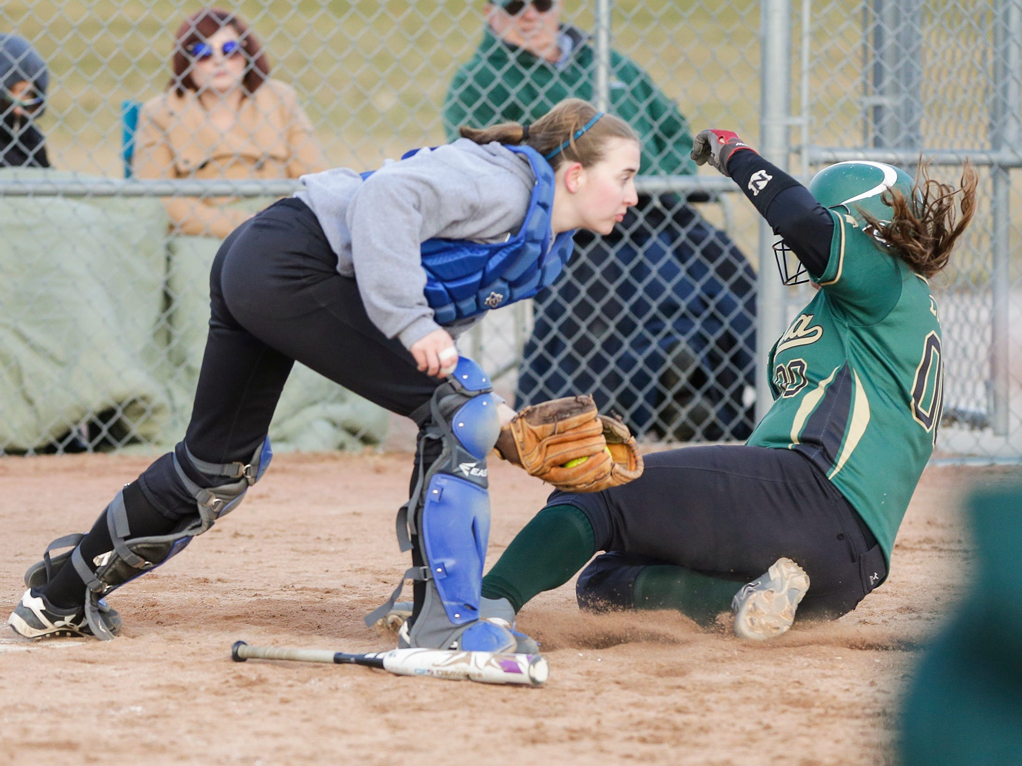 Laconia High School softball's Abby Luczak gets tagged out at home by Winnebago Lutheran Academy's catcher April 9, 2019 during their game in Fond du Lac, Wis. Laconia won the game 25-9. Doug Raflik/USA TODAY NETWORK-Wisconsin