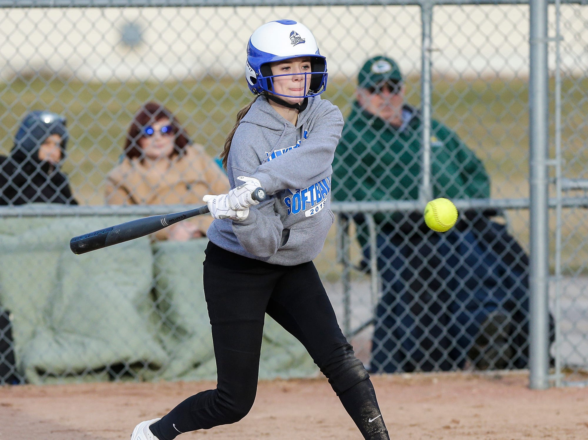 Winnebago Lutheran Academy softball's Rylee Loehr hits a single in the fourth inning against Laconia High School April 9, 2019 during their game in Fond du Lac, Wis. Laconia won the game 25-9. Doug Raflik/USA TODAY NETWORK-Wisconsin