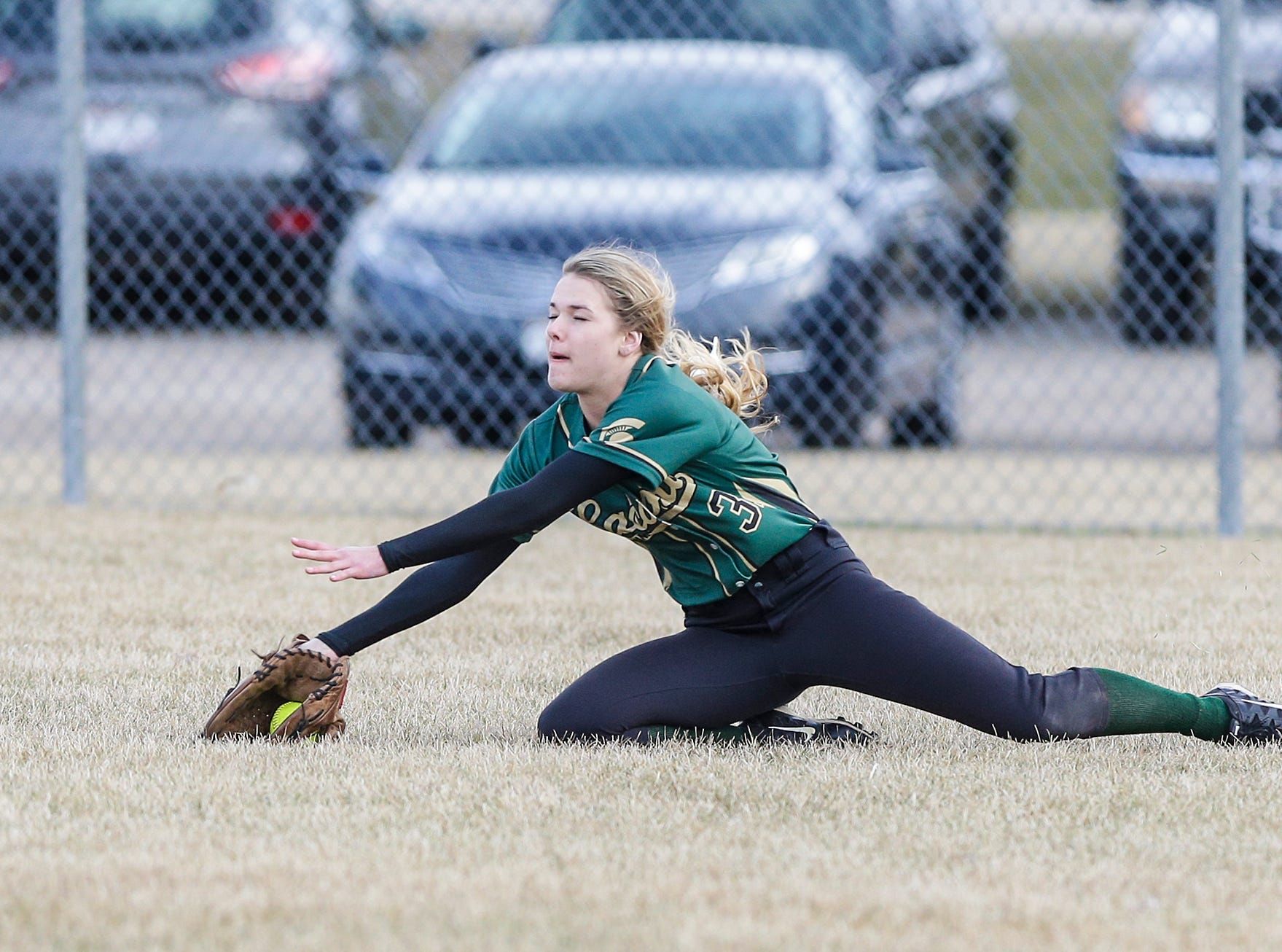 Laconia High School softball's Hailey Bartz attempts a diving catch against Winnebago Lutheran Academy but can't hold onto the ball April 9, 2019 during their game in Fond du Lac, Wis. Laconia won the game 25-9. Doug Raflik/USA TODAY NETWORK-Wisconsin