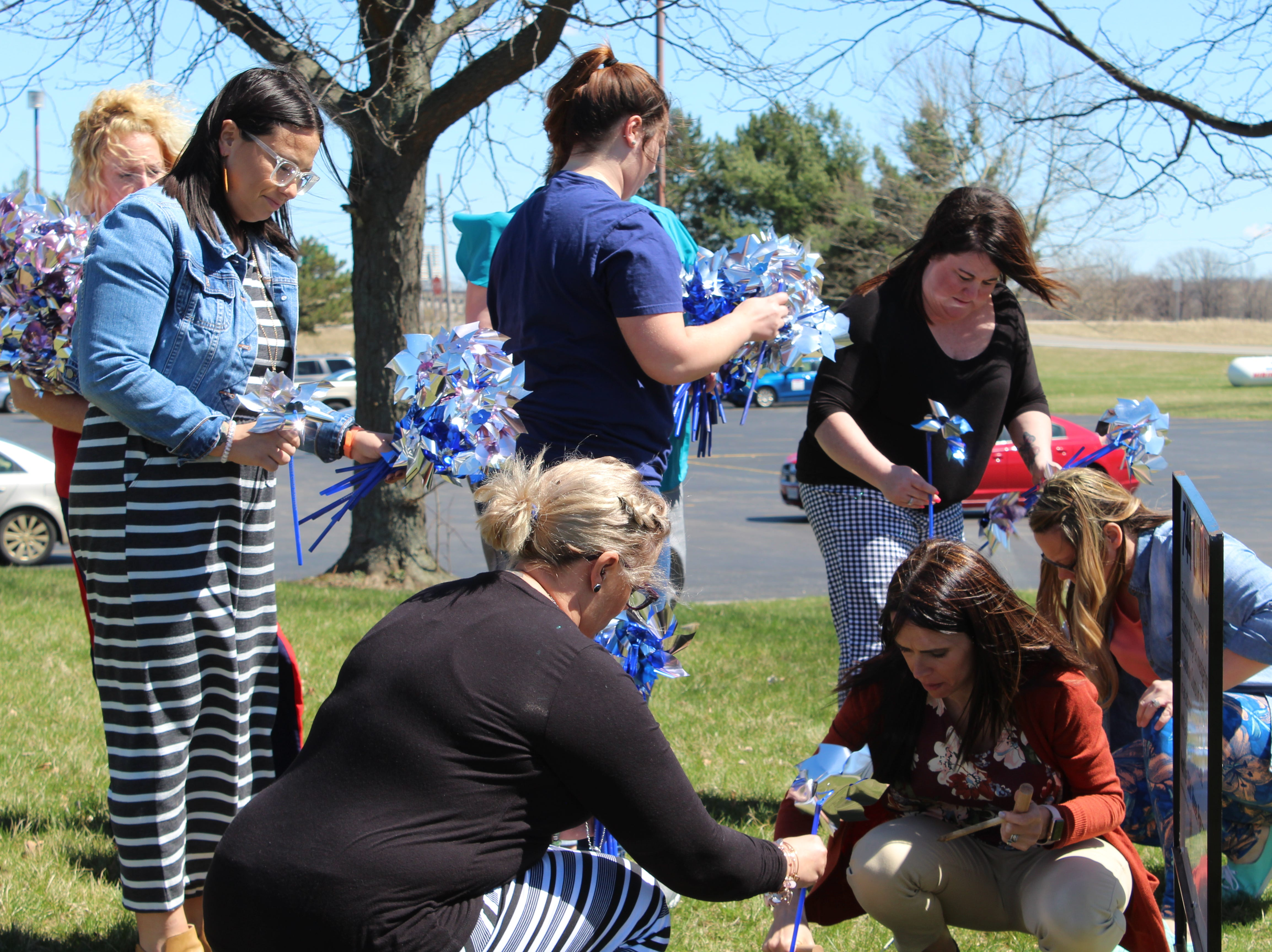 Sandusky County Department of Job and Family Services workers planted pinwheels to support the number of children they assisted in 2018.