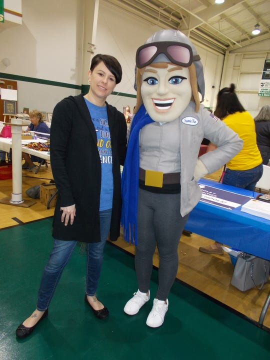 Frannie Flier stands with with Crystal Henson, a volunteer with Clyde-Green Springs Schools, during the Clyde Business Expo.