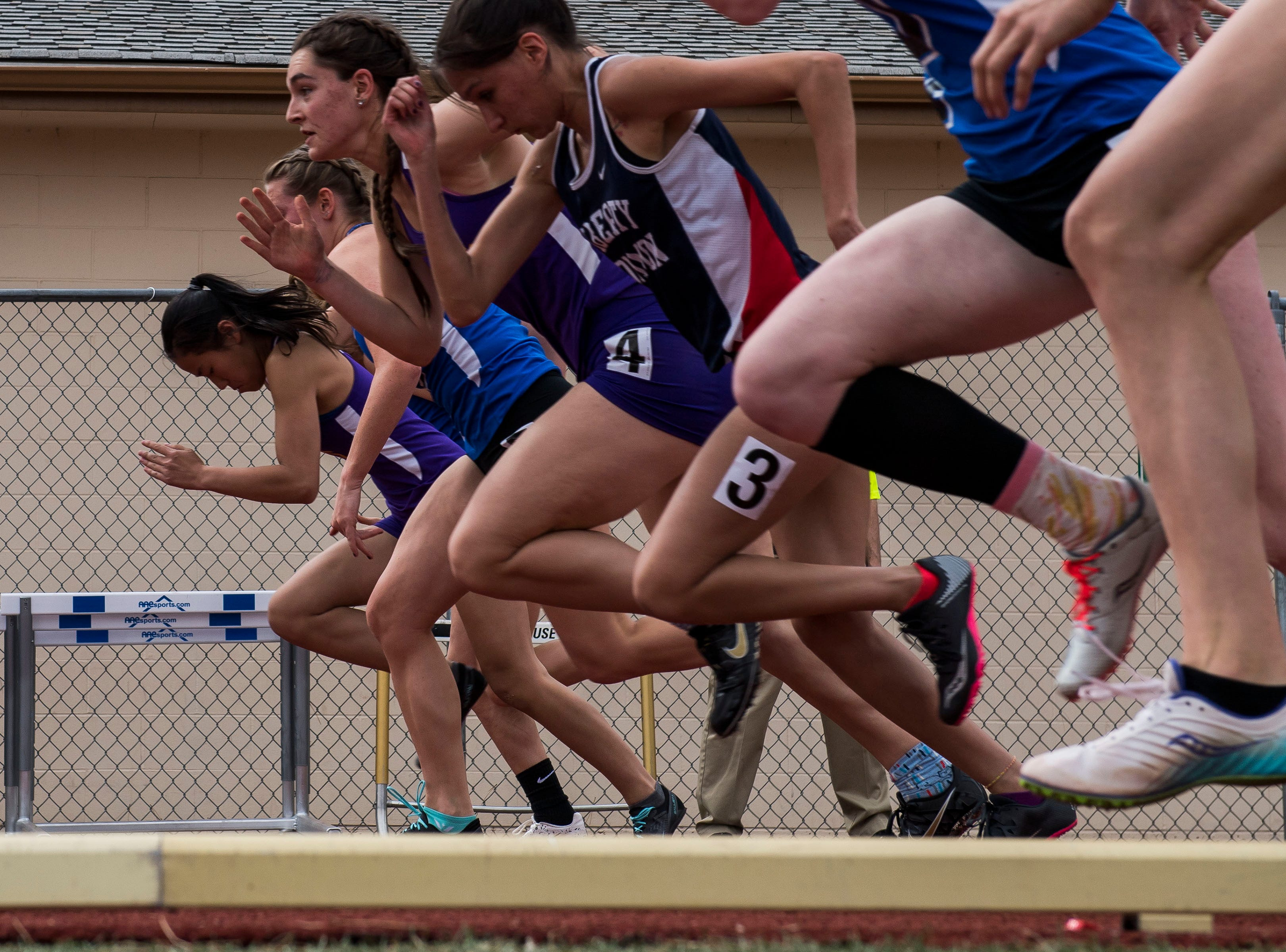 Local girls compete in the girls 100-meter dash during the Randy Yaussi City Track Championships on Tuesday, April 9, 2019, at French Field in Fort Collins, Colo.
