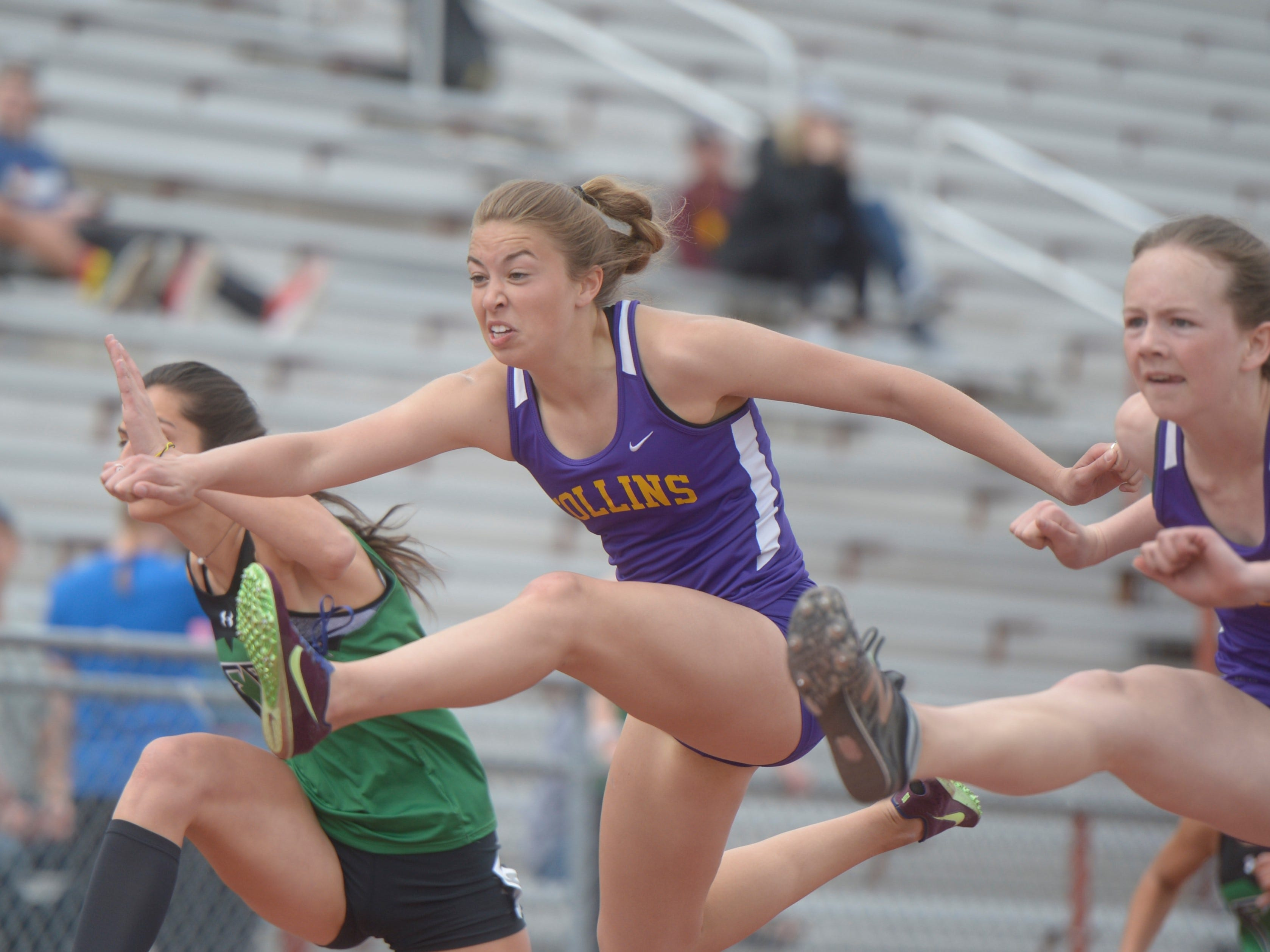 Fort Collins High School's Samnatha Gordon, middle, runs the 100 hurdles at the city meet at French Field on Tuesday, April 9, 2019.