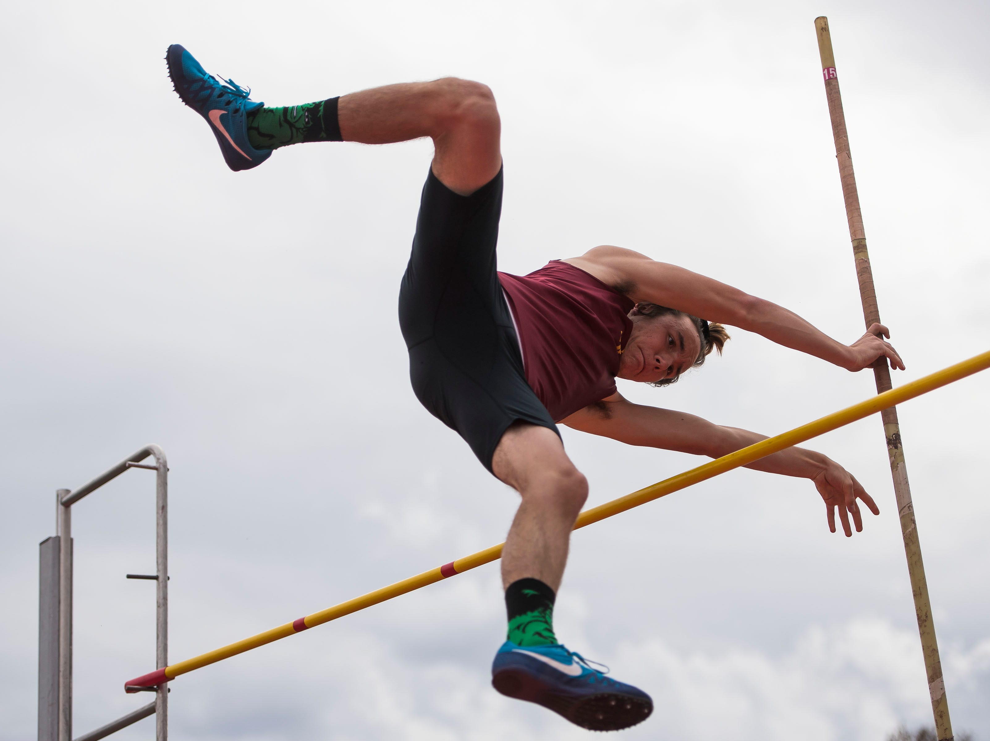 Rocky Mountain's Bridger Fry competes in the boys pole vault during the Randy Yaussi City Track Championships on Tuesday, April 9, 2019, at French Field in Fort Collins, Colo.