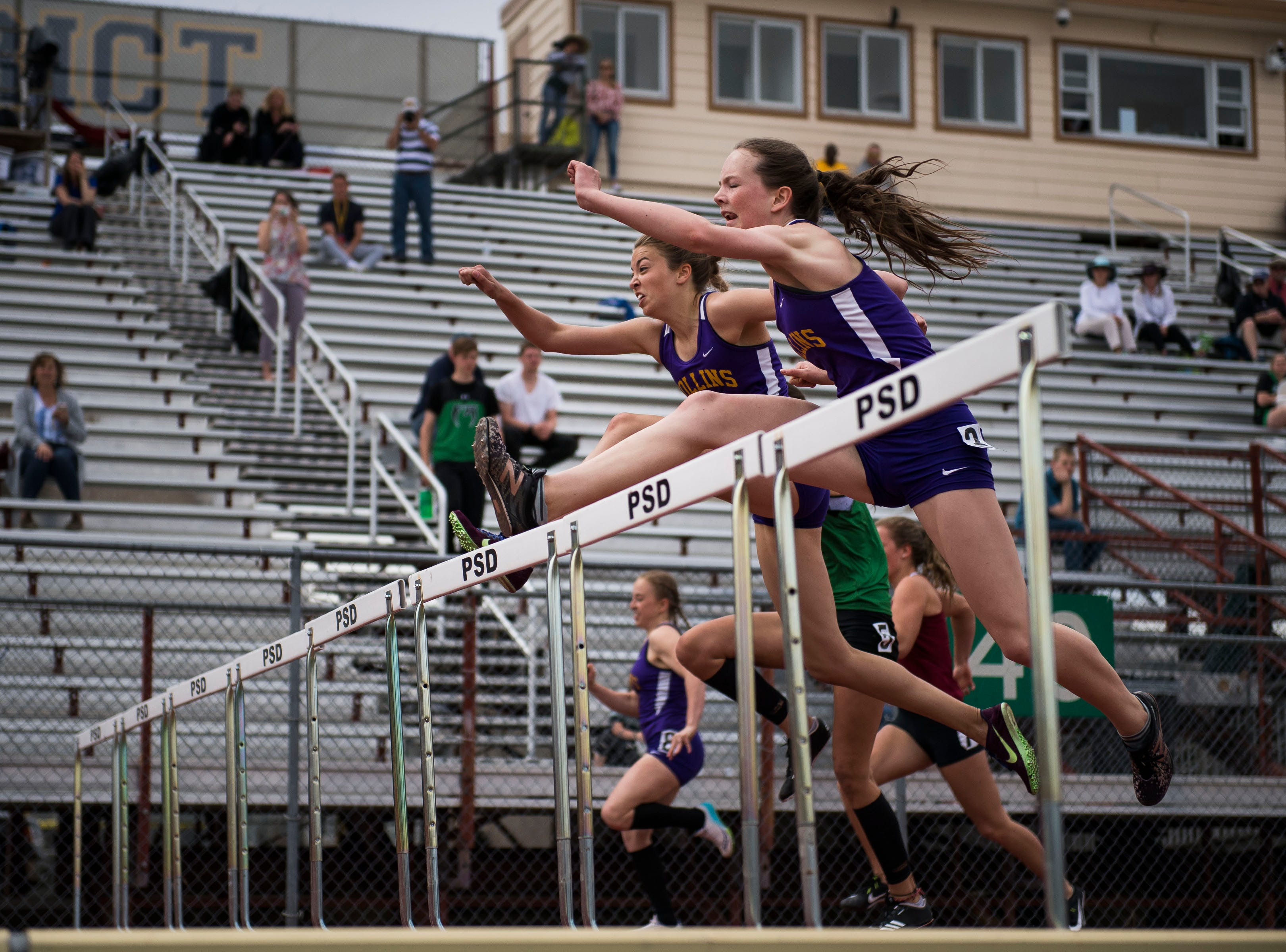 Fort Collins High School'd Riley Dodd, right, and Samantha Gordon lead their heat in the girls 100-meter hurdles during the Randy Yaussi City Track Championships on Tuesday, April 9, 2019, at French Field in Fort Collins, Colo.