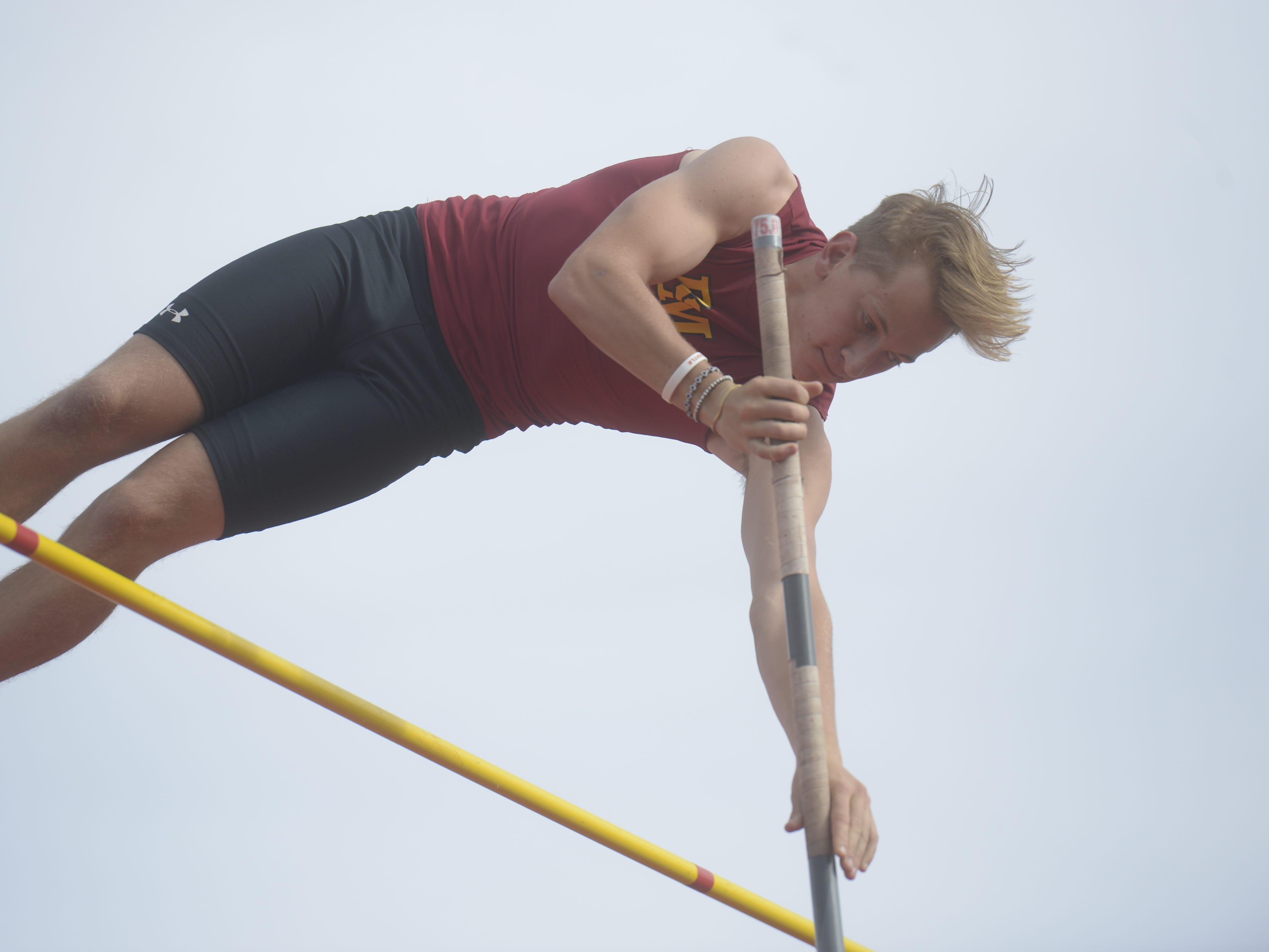 Rocky Mountain High School's Holden Lefke competes in the pole vault at the Fort Collins city meet at French Field on Tuesday, April 9, 2019.