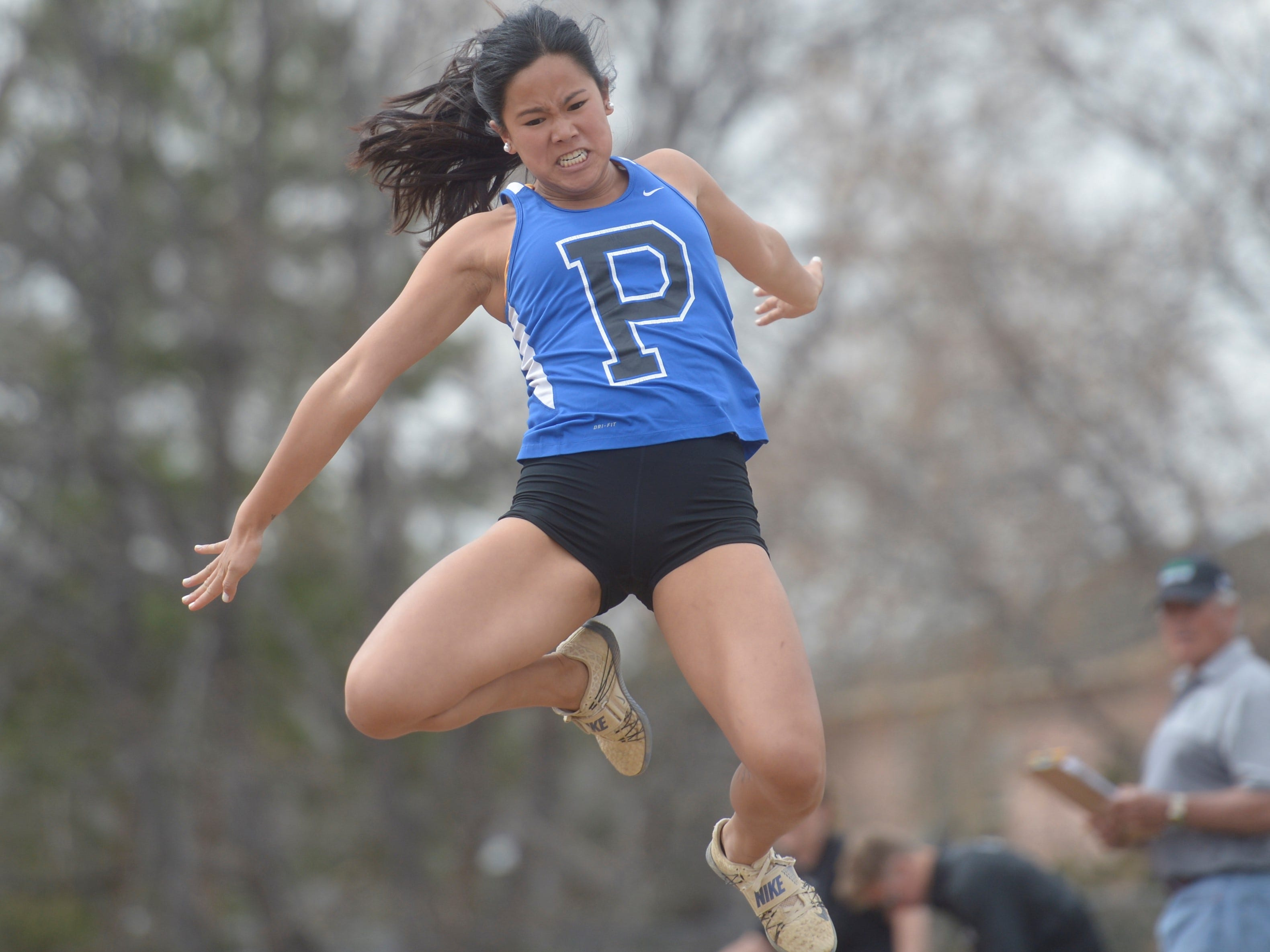 Poudre High School's Zoe Drigot competes in the triple jump at the Fort Collins city meet at French Field on Tuesday, April 9, 2019.